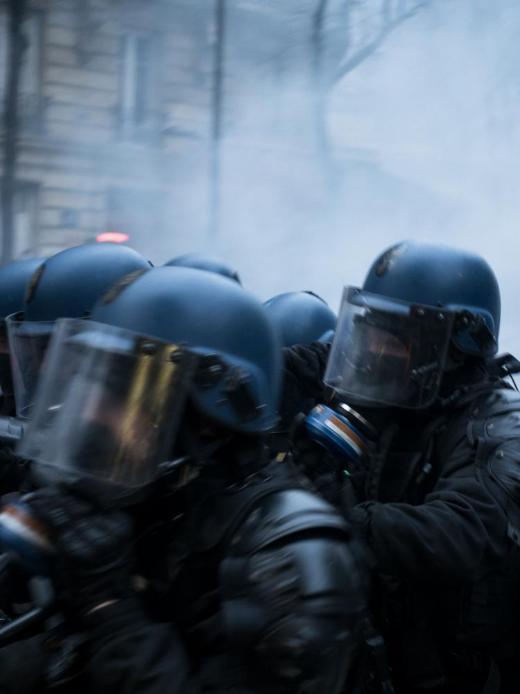 Violent clashes erupted between police forces and demonstrators few hundred meters after a march started in Paris. Tear gases were thrown at the demonstrators to disperse the march, some fought back others ran away. Gambetta avenue, Paris, France, the 5th of December 2020.