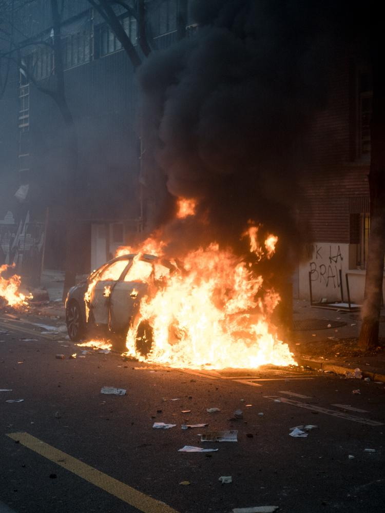 Violent clashes erupted between police forces and demonstrators few hundred meters after a march started in Paris. Tear gases were thrown at the demonstrators to disperse the march, some fought back others ran away. Cars have been burnt by rioters in the avenue. Gambetta avenue, Paris, France, the 5th of December 2020.