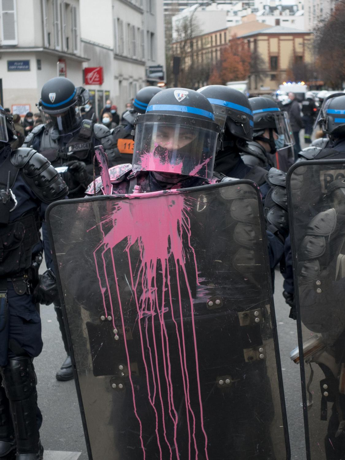 """Policemen watching the rally against the called """"Sécurité Globale"""" (Global Security) bill during a march in Paris were targeted by the rioters with paint. Gambetta avenue, Paris, France, the 5th of December 2020."""