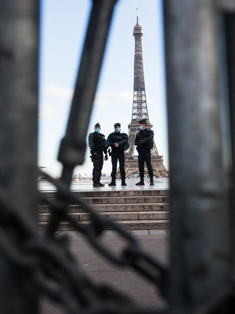 "From the Human Rights Square and behind their barricades, policemen are watching the rally against the controversial so called ""Sécurité Globale"" (Global Security) bill. Trocadero Square, Paris, France, the 21st of November 2020."