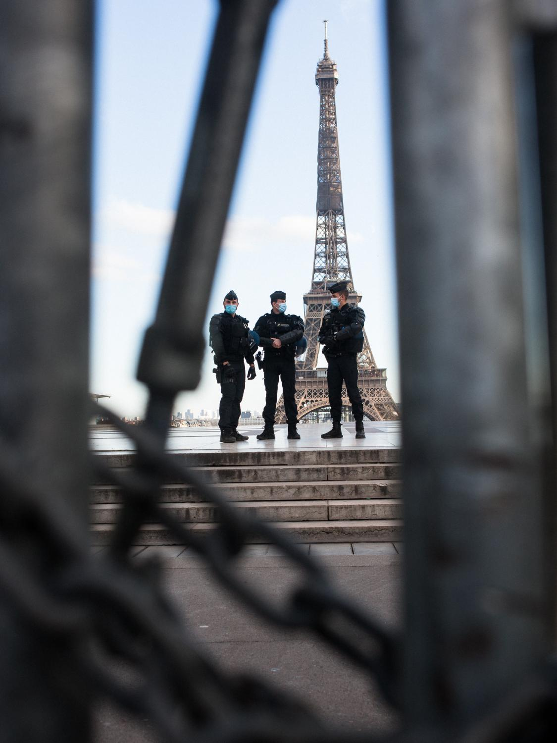 """From the Human Rights Square and behind their barricades, policemen are watching the rally against the controversial so called """"Sécurité Globale"""" (Global Security) bill. Trocadero Square, Paris, France, the 21st of November 2020."""