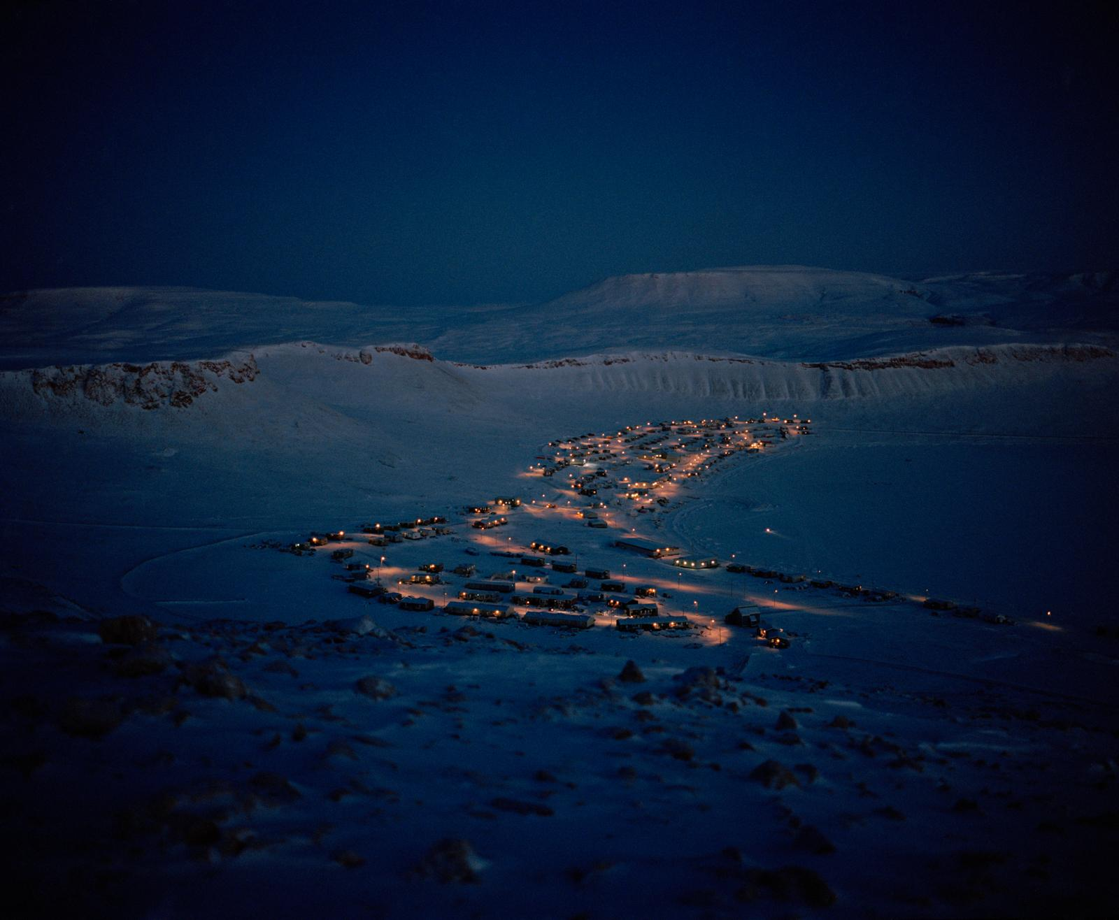 The community of Arctic Bay, Nunavut, around midday in December.