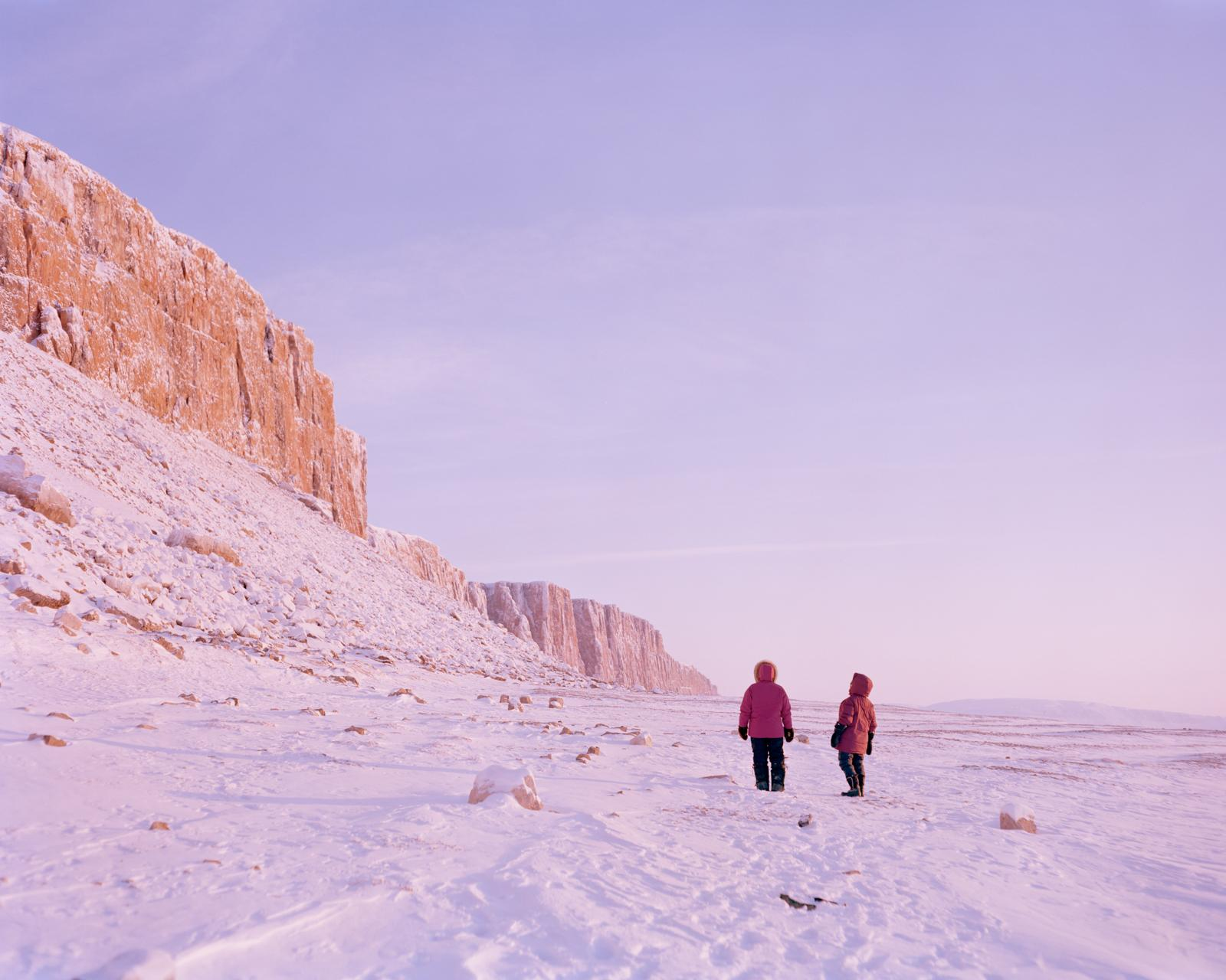 On the edge of the sea ice, Tagaaq Tatatoapik accompanies an Inuit elder to the coastal site near Arctic Bay where she was raised in an outpost camp as a child.