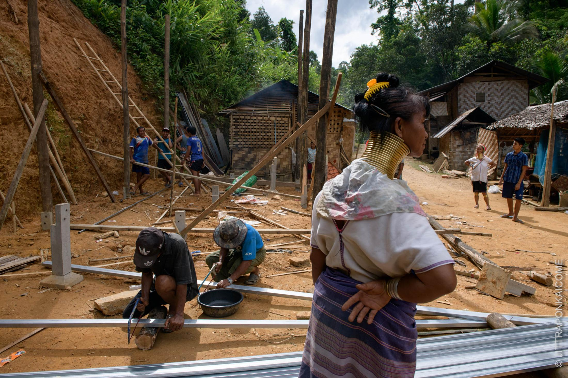 Villagers gathered helping to build a house for their neighbor, the Kayan Long Neck. Their house was under construction during the COVID-19.