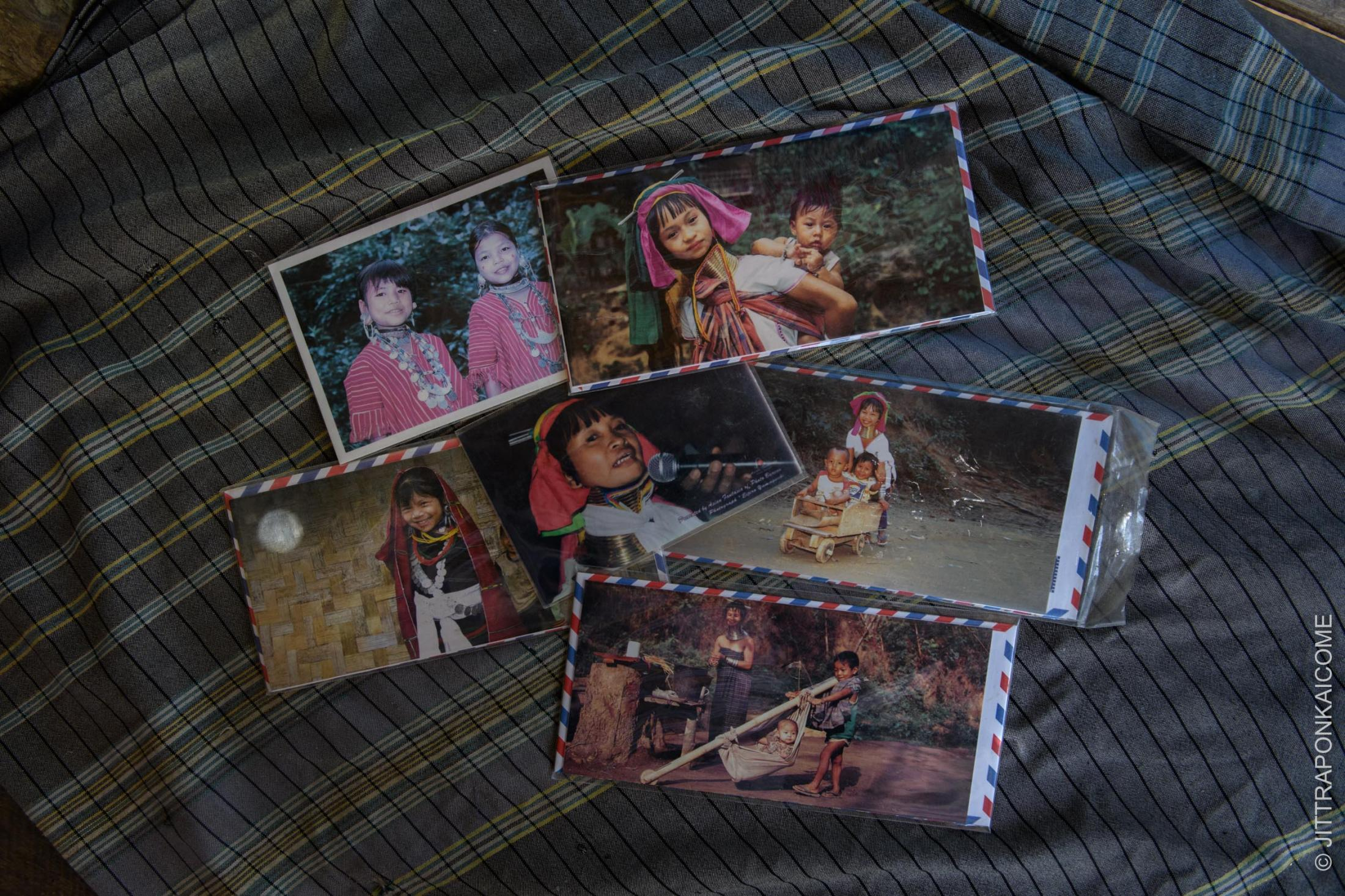 A set of postcard souvenirs displayed the livelihood of the Kayan and Kayaw tribes are hardly making money due to a lack of tourists. Ban Nai Soi, Mae Hong Son, Thailand.