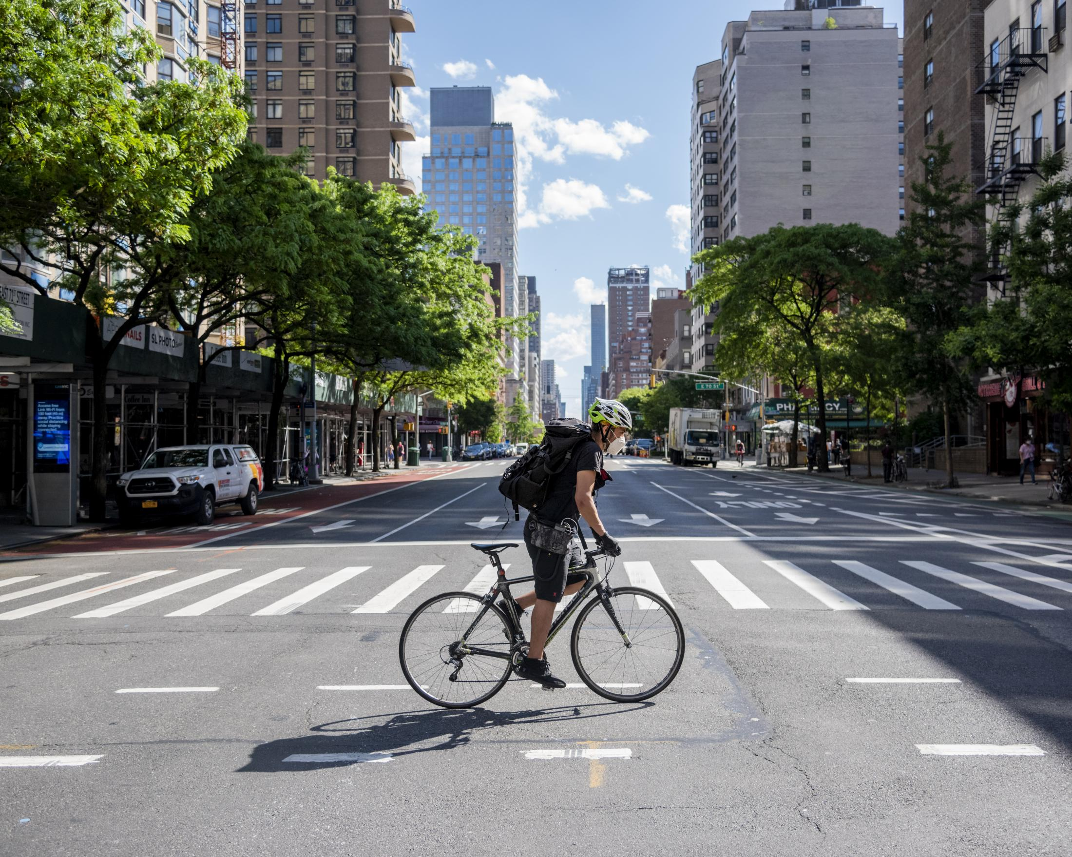 Jaciel biking over an empty Midtown Manhattan intersection during the lockdown in New York. He explains in an interview: 'For me as a cyclist, being able to use the city this empty, felt like a privilege, almost like in a videogame.'.