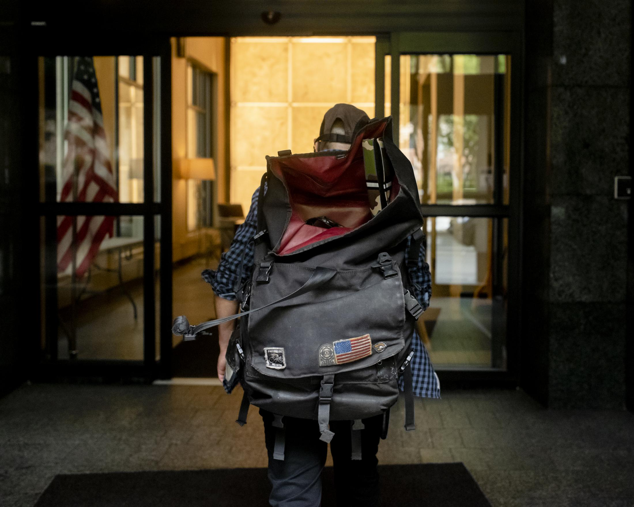 Carlos, an Uruguayan food delivery worker, entering a building in Wall Street, Manhattan. Carlos lives as an illegal immigrant in the state of New Jersey and commutes every day to work for an Italian restaurant, with almost zero protection either from the restaurant or the mobile food apps.