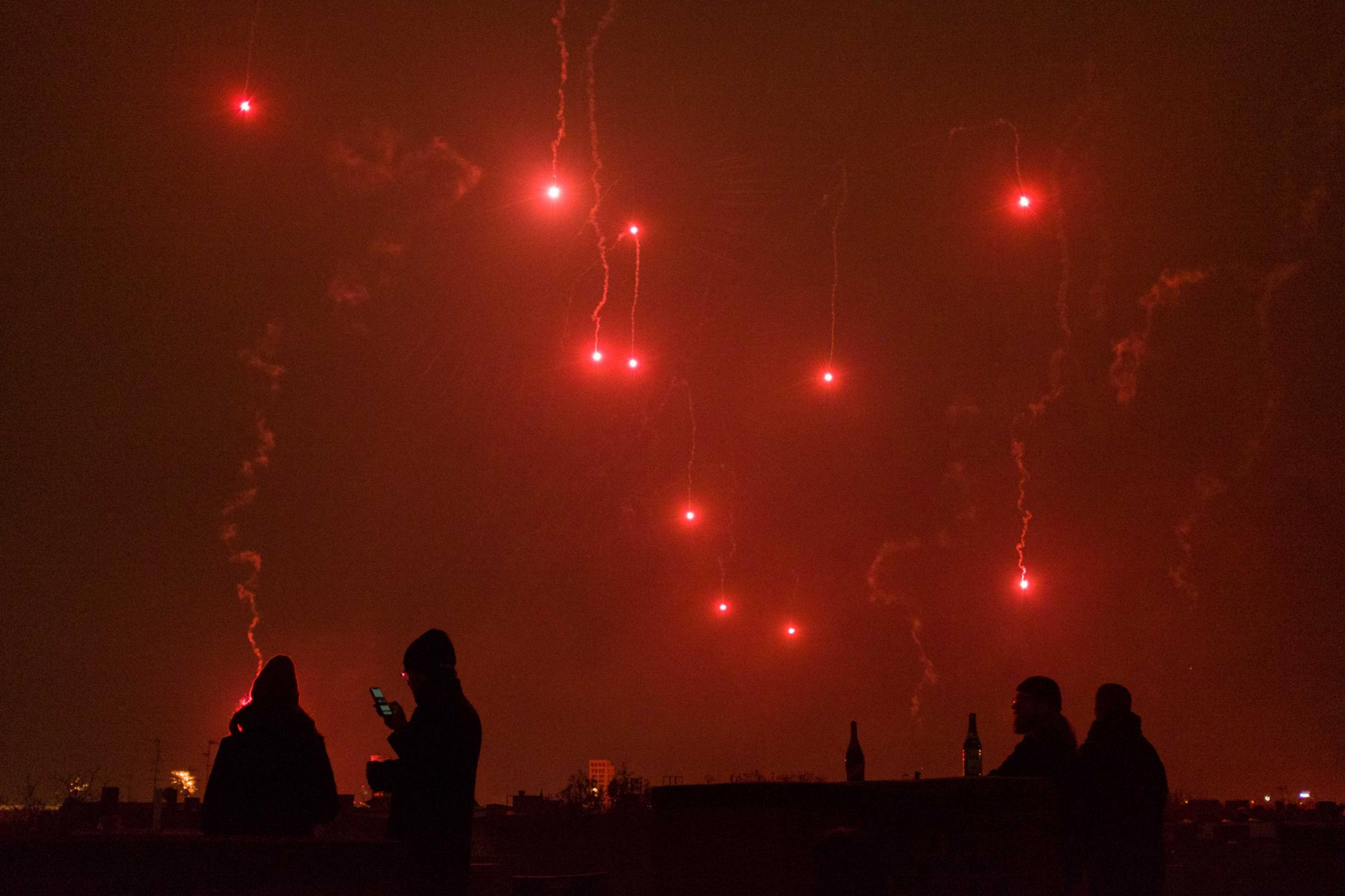 People begin the new year physically distant on top of a roof in Berlin. January 1, 2021.