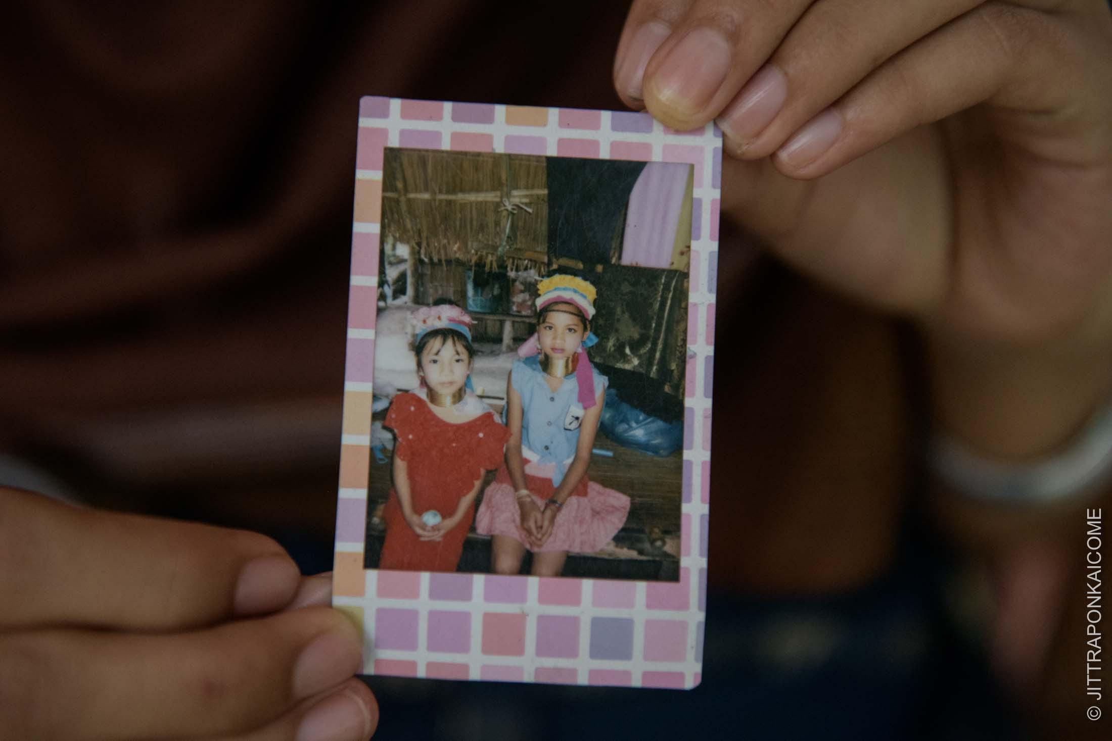 Arathai shows a picture taken 5 years ago with her friend on the left, Ma Prai on the year she moved from Karenni state to join the tourism industry in Chiang Mai. She was 14 years old when the COVID-19 hit the kingdom forced her Ma Prai to move back to her homeland - Arathai said she missed her.