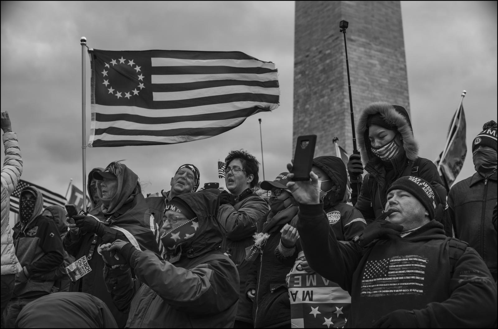 At the Washington Monument, supporters react as President of the United States speaks to overturn the November 2020 elections. Washington D.C. 01/06/21.