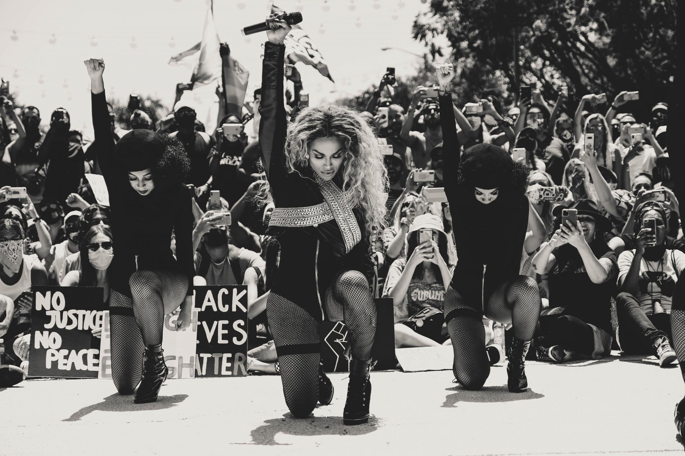 """LOS ANGELES, CALIFORNIA - JUNE 14: Michell'e """"Miss Shalae"""" Michaels (C) performs at the All Black Lives Matter Solidarity March on June 14, 2020 in Los Angeles, California. Anti-racism and police brutality protests continue to be held in cities throughout the country over the death of George Floyd, who was killed while in police custody in Minneapolis on May 25th. (Photo by Sarah Morris/Getty Images)"""