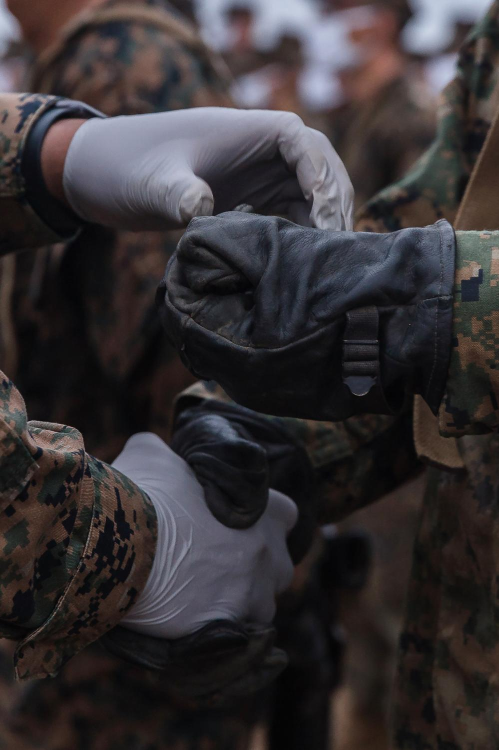 A recruit is given an Eagle, Globe and Anchor pin after completing the Crucible at Camp Pendleton.