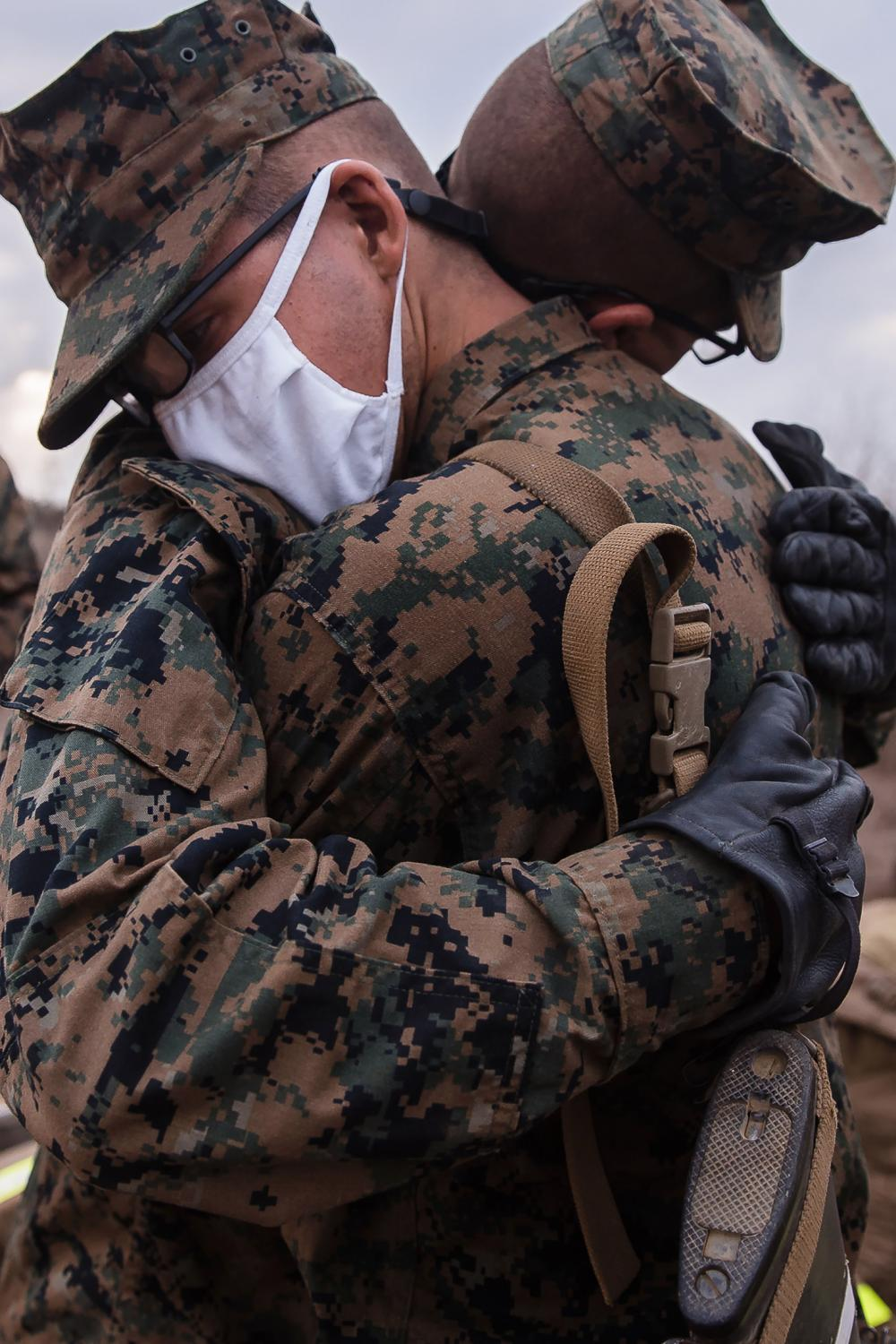 Two recruits hug one another after completing the Crucible that lasted 54 hours.