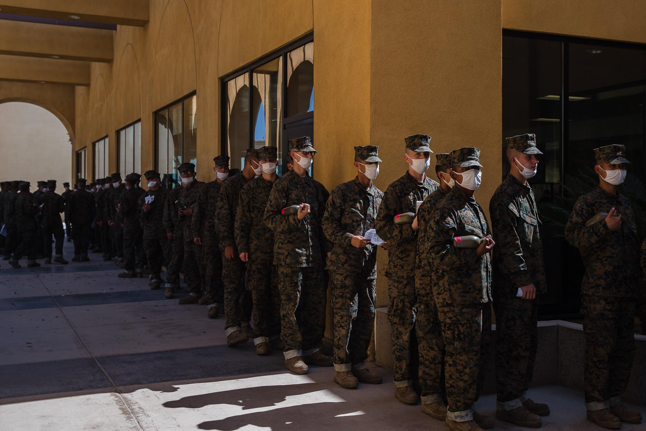 Men wait in line for chow time at the Marine Corps Recruit Depot San Diego on October 8, 2020.