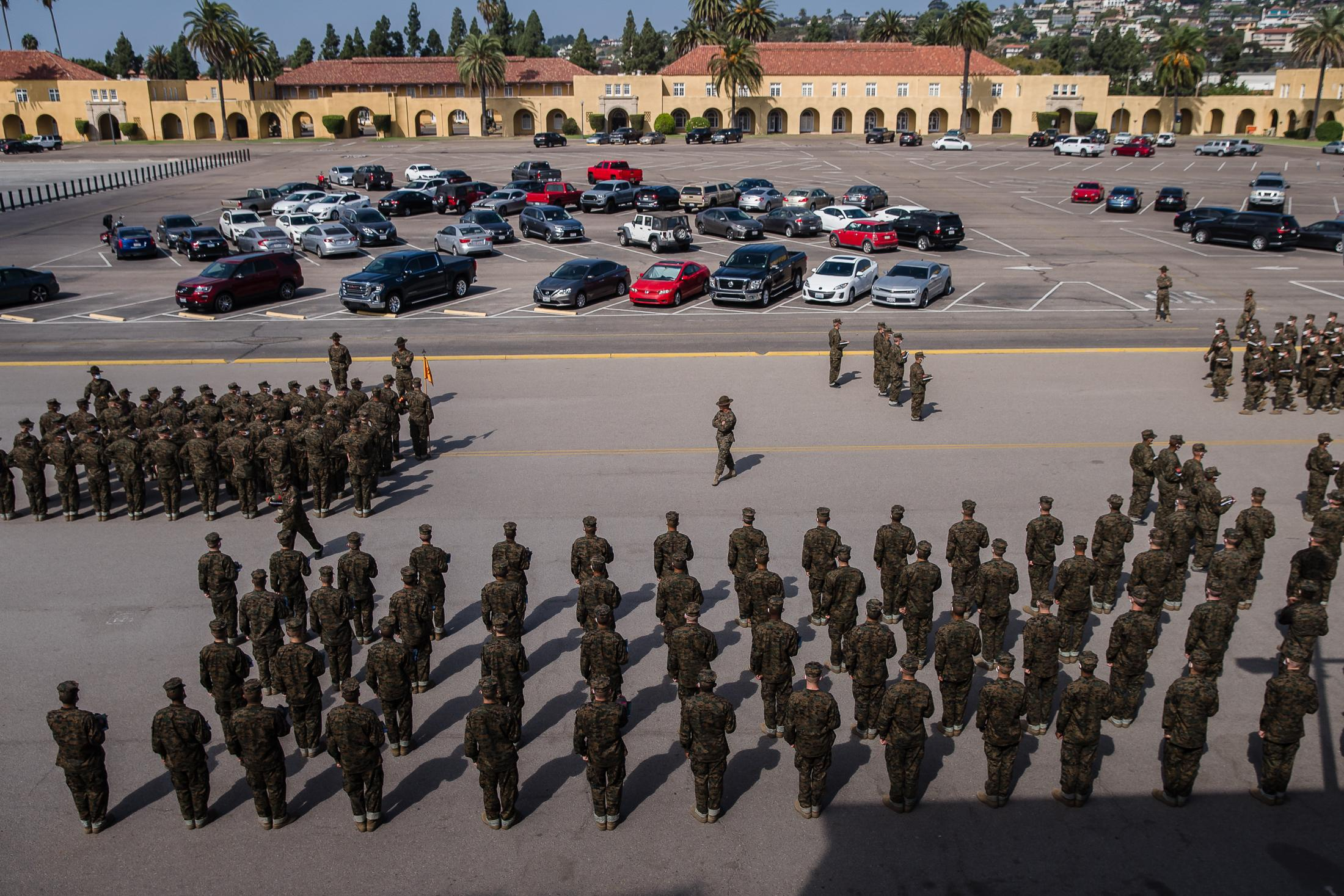 Recruits stand in formation before they walk to the auditorium for class at the Marine Corps Recruit Depot San Diego.