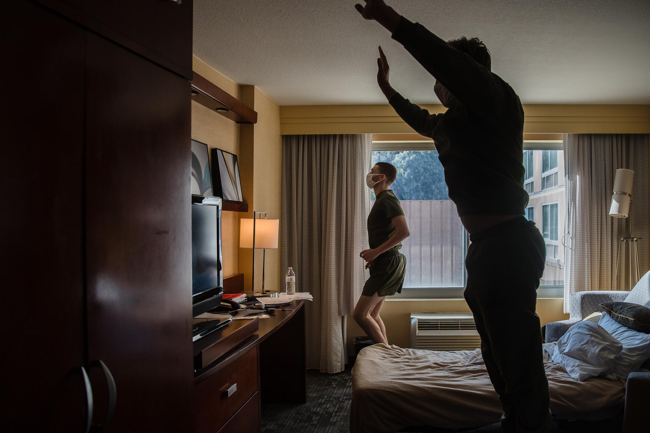 Jacob Jones (right) and Coulter Whitlow (left) have been sharing a room, they are part of Company Fox and have been in quarantine for a week at the Courtyard Marriott in San Diego on October 13, 2020. They work out daily to stay active and try to challenge one another with how long they can do certain exercises.
