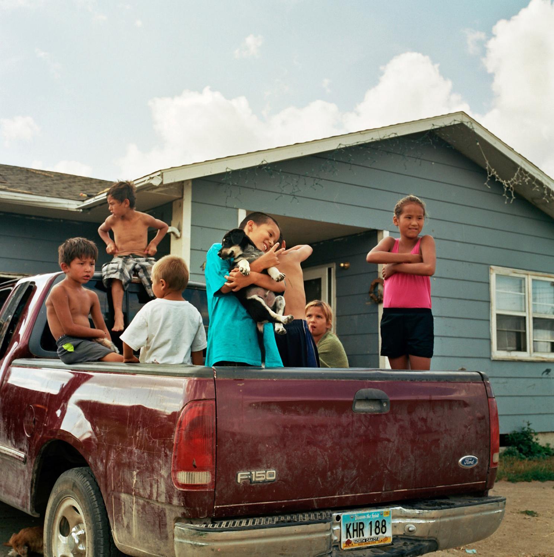 Children playing in a truck in Fort Totten, Spirit Lake. North Dakota. August 2014