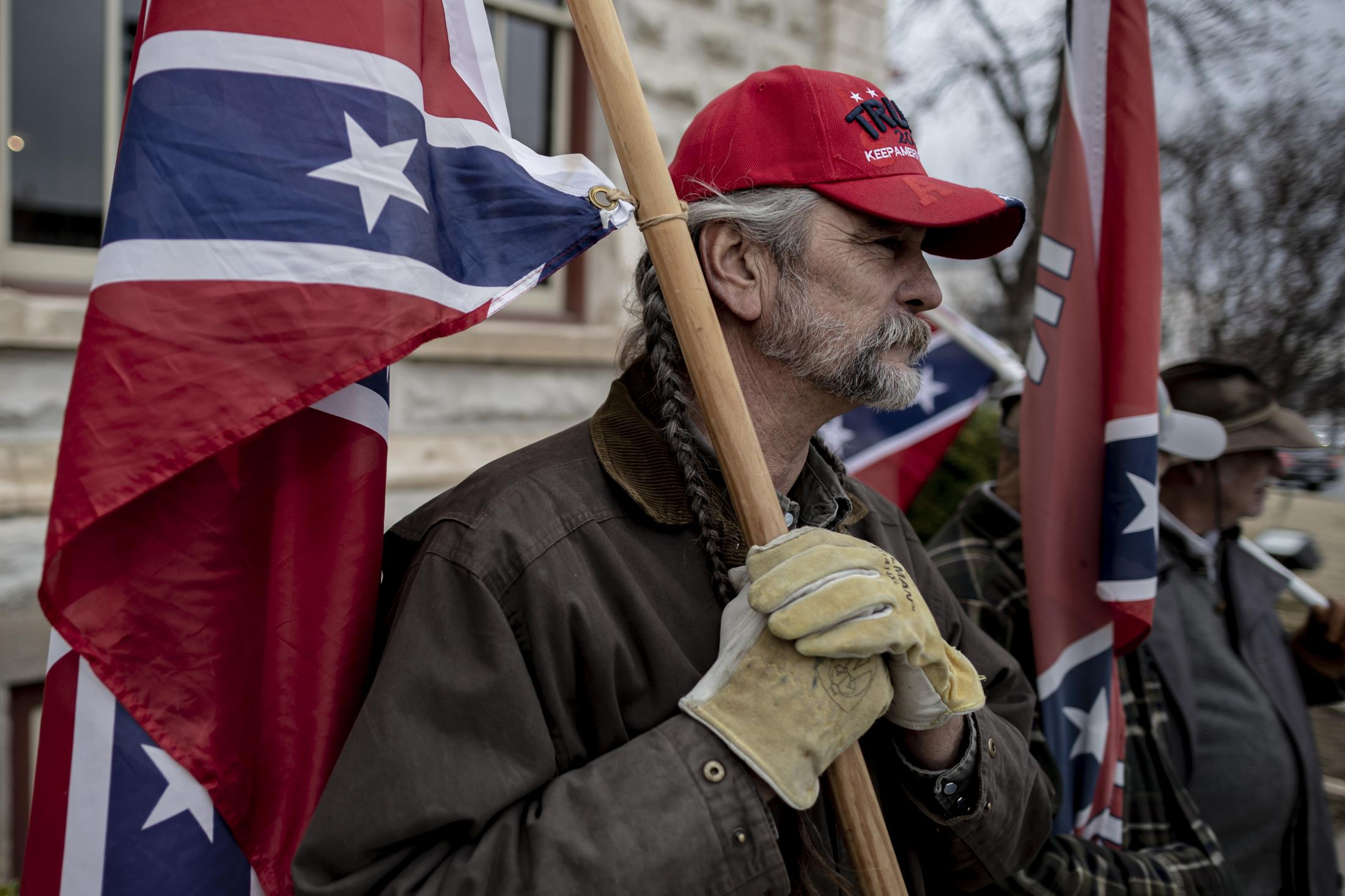 A Weatherford man, who is a member of the Sons of the Confederacy, holds a confederate flag close to his chest during an annual Confederate Veterans Memorial Day at the towns square. This Memorial Day is held one day after Martin Luther King Jr Day.