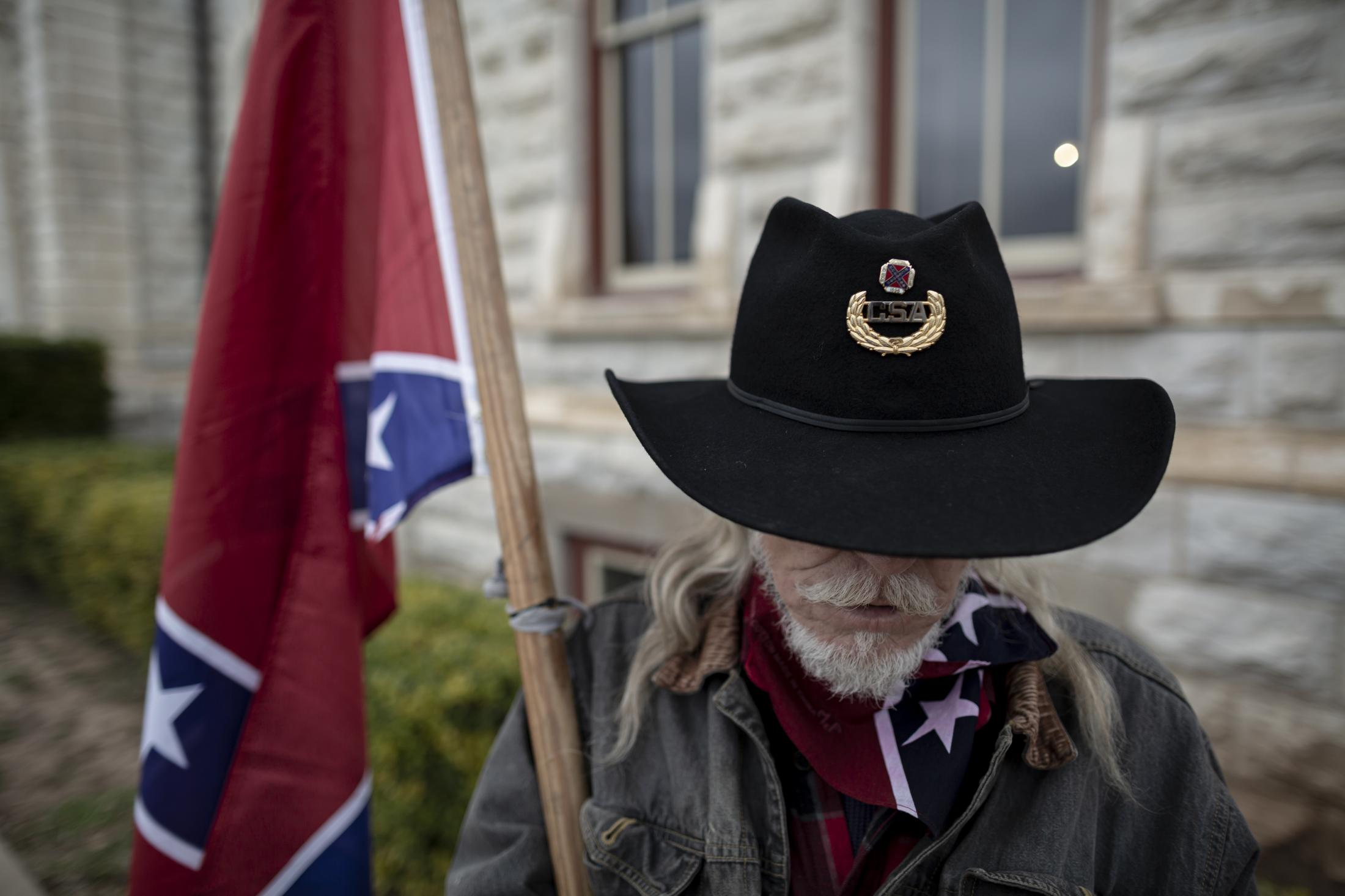 A member of the Sons of the Confederacy attends a annual Confederate Veterans Memorial Day at the Parker County Court House. The Memorial Day is held one day after Martin Luther King Jr Day. This group stands against the removal of the statue and to those who want it gone.