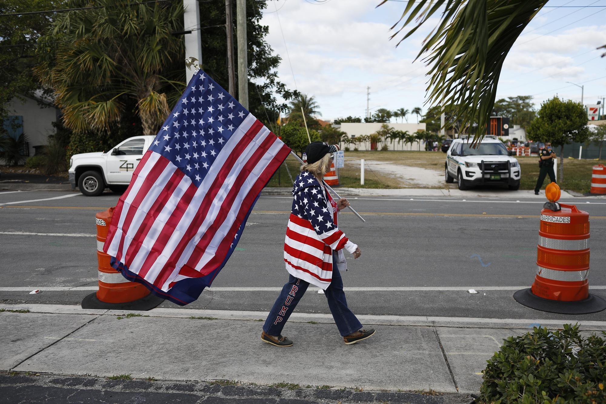 Supporters of President Donald Trump stand near the road as he arrives in West Palm Beach, Florida, U.S., January 20, 2021. REUTERS/Marco Bello