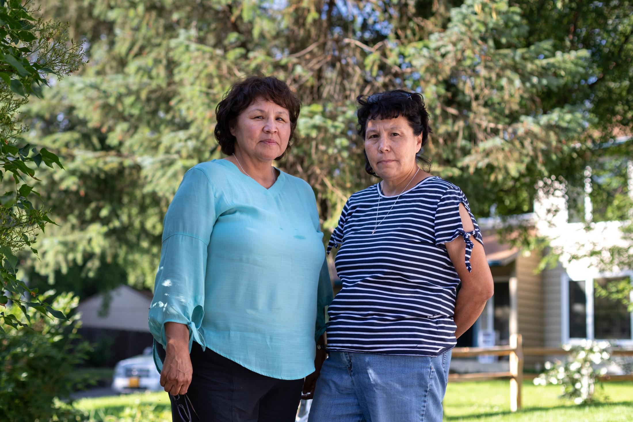 "Sue Anelon, left, and Lisa Reimers in Anchorage, Alaska. The two sisters are involved with the Native corporation of the village of Iliamna, one of five village corporations that support the Pebble Mine project and that has negotiated to allow the mine access to 68,000 acres of its land. The Canadian mining company, Northern Dynasty Minerals, would pay to improve local infrastructure in several villages and pay out at least $3 million in dividends to locals. Reimers told the New York Times that her parents ""didn't see Iliamna surviving without a project like Pebble."""