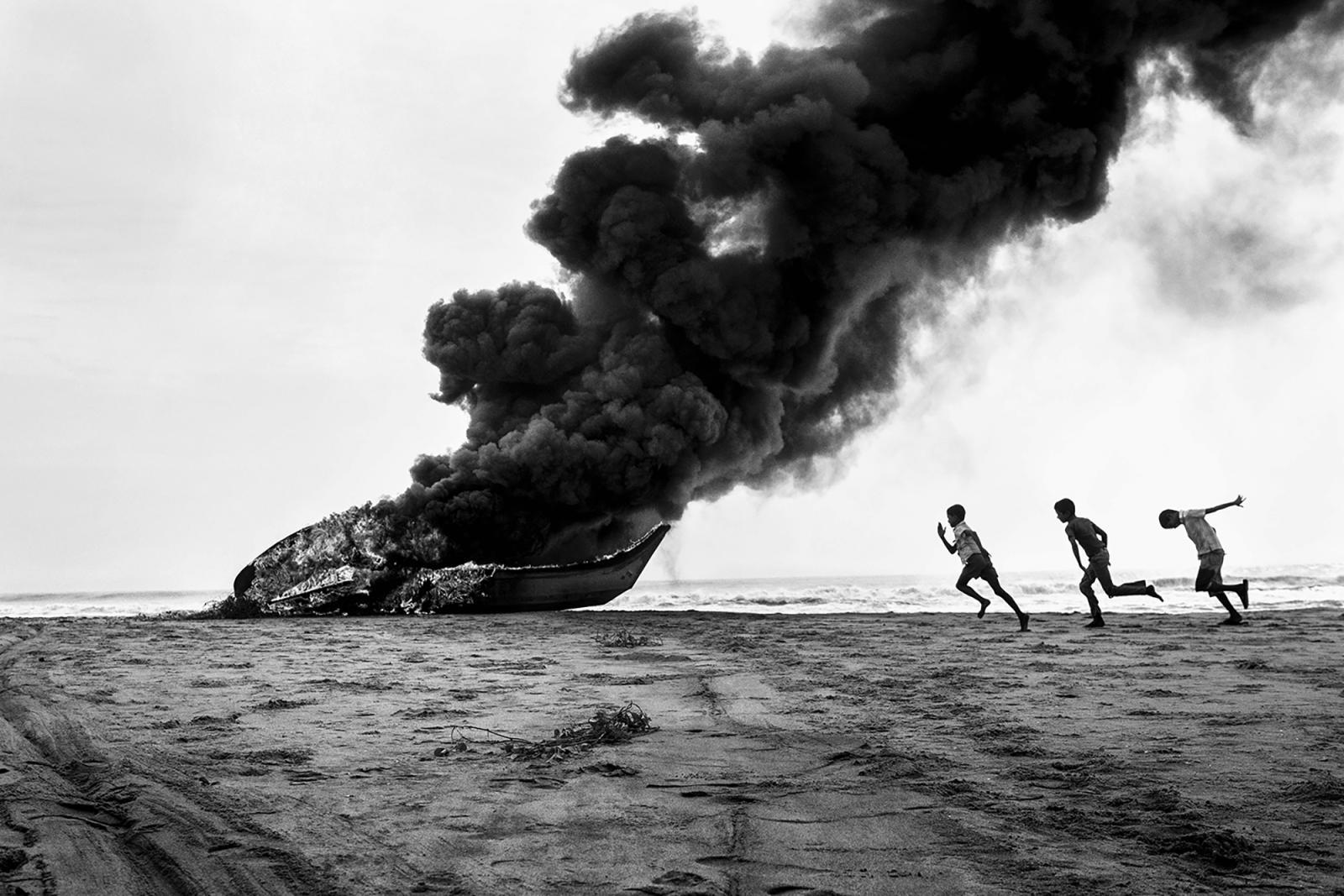 Photography image - Loading Fired_Boat__mouhamed_moustapha___photographer_pondicherry__mousty_photos__seashore_pondicherry.jpg