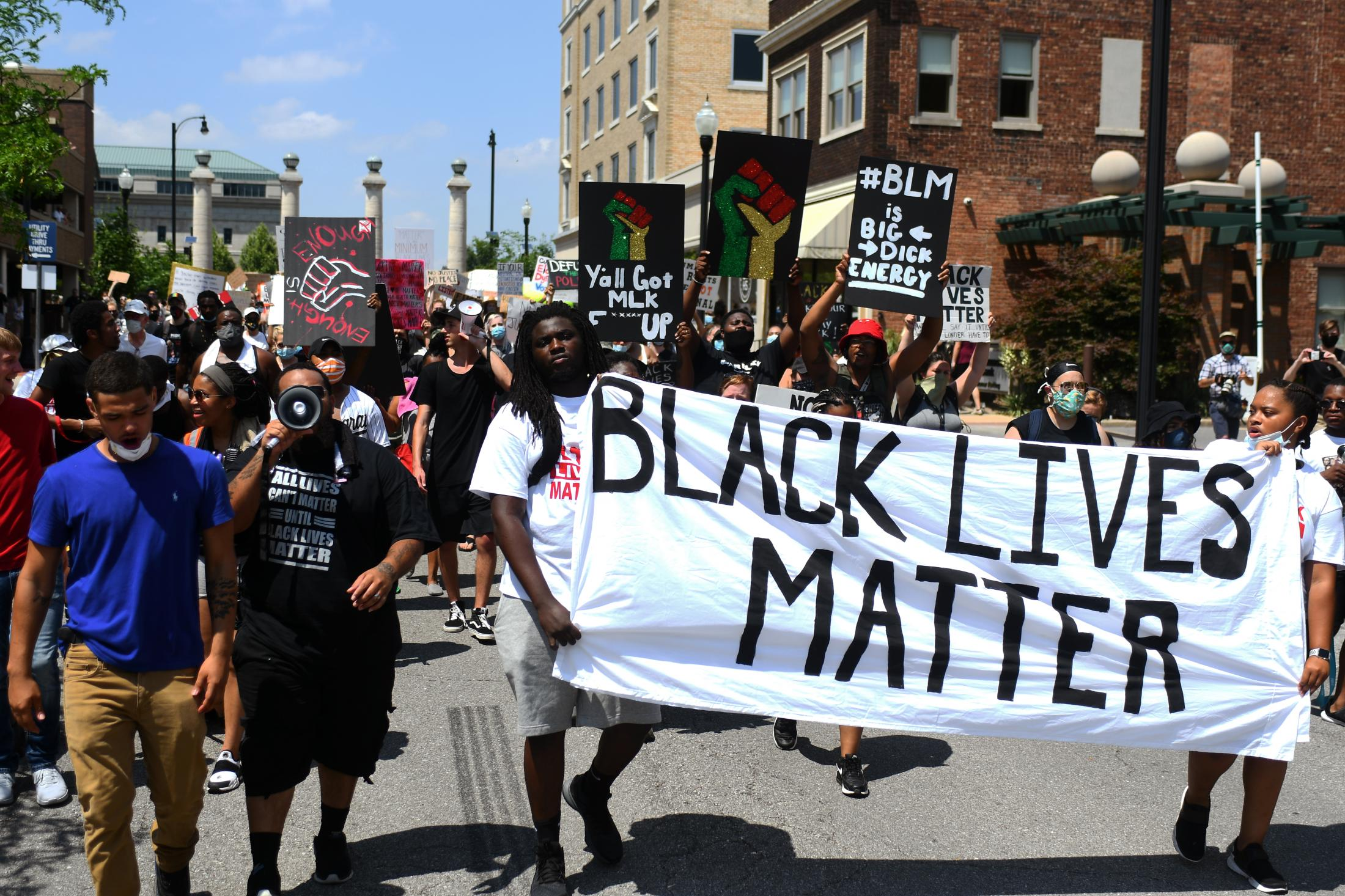 """Hundreds of protesters march after hearing speakers outside of the Boone County Courthouse on Sunday, June 7, 2020, in Columbia, Missouri. Attendees went around Downtown Columbia holding signs and shouting chants like """"Black Lives Matter"""" and """"No Justice, No Peace""""."""