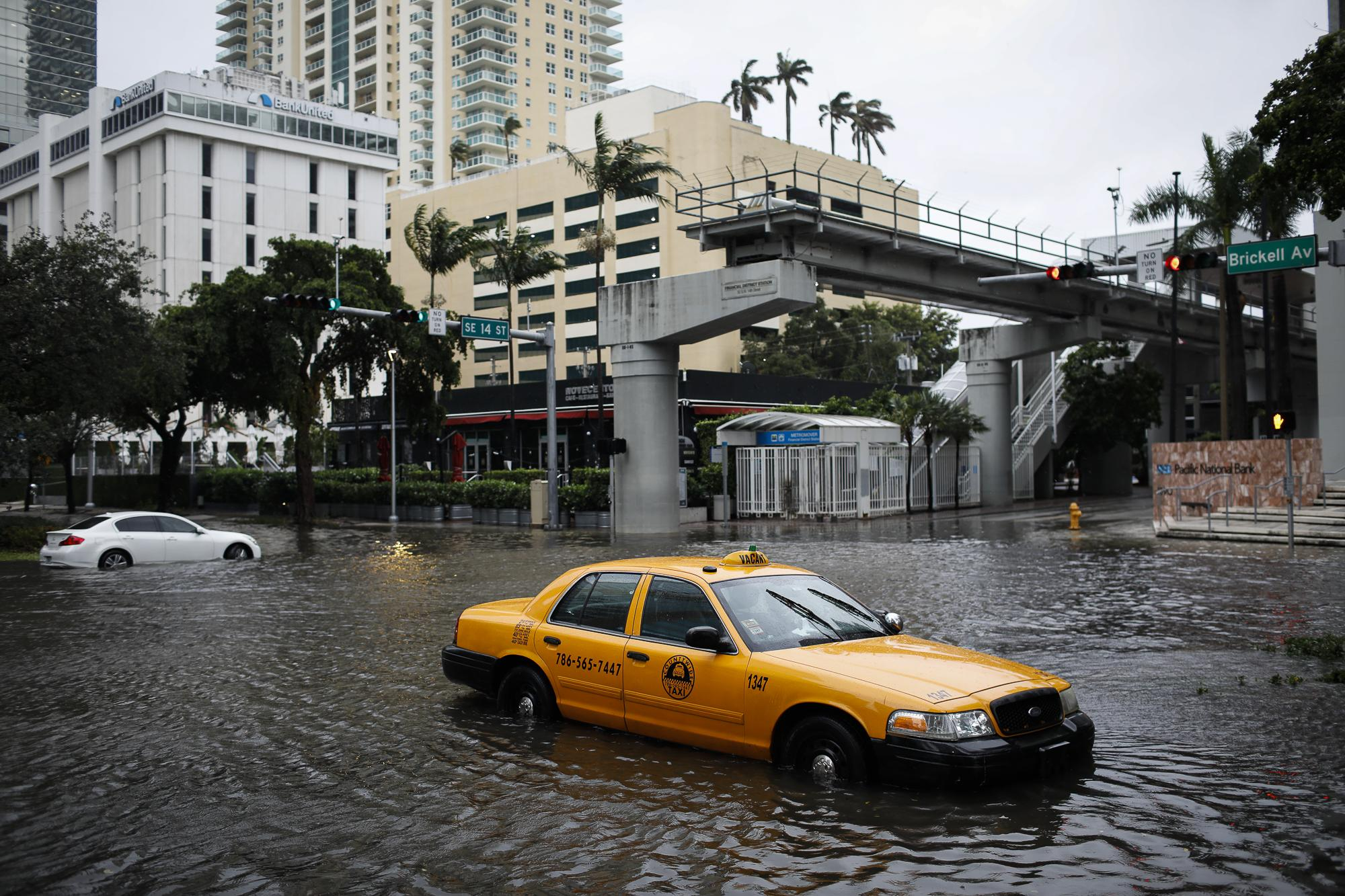 A damaged taxi is seen in floodwaters caused by Storm Eta in a street at the Brickell neighborhood in Miami, Florida, U.S., November 9, 2020. REUTERS/Marco Bello