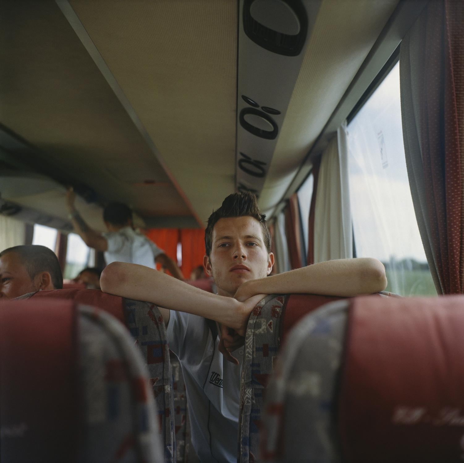 Matthias Tischer (tor-keeper) looks on in the 1.FCM bus during the trip to Hehenmöseln where the team will play the last friendly match of the season before the summer break, in Magdeburg.