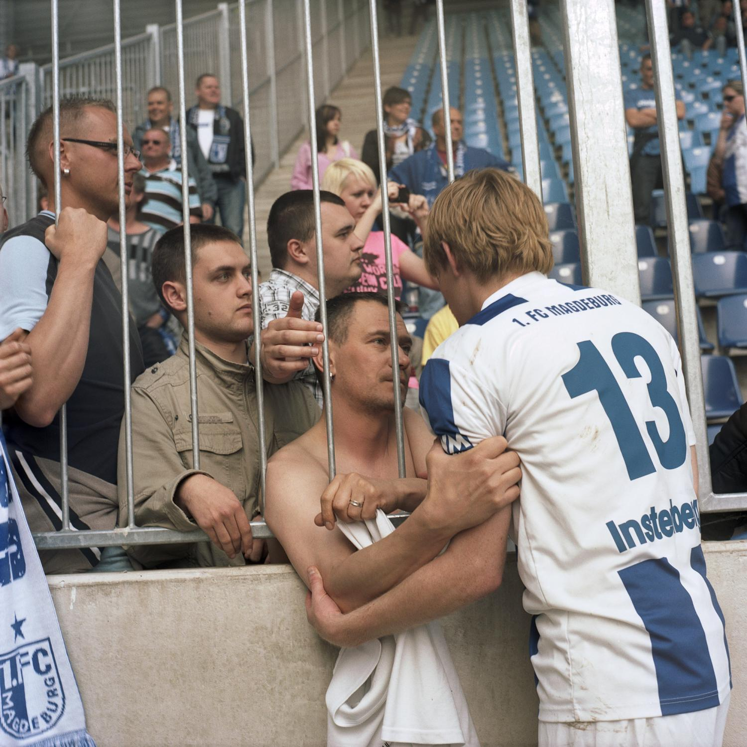 The last day of the season 2009/2010, a supporter is holding Moritz Instenberg through the gate, in the stadium in Magdeburg. He is the youngest of the team and has been the best player in the last months, being the only one the supporters still believe in, after an overall disappointing season.