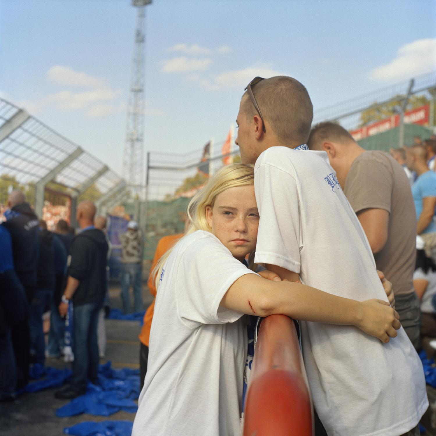 A couple of supporters hugs in the last minutes of the derby Halle - Magdeburg, in Halle.