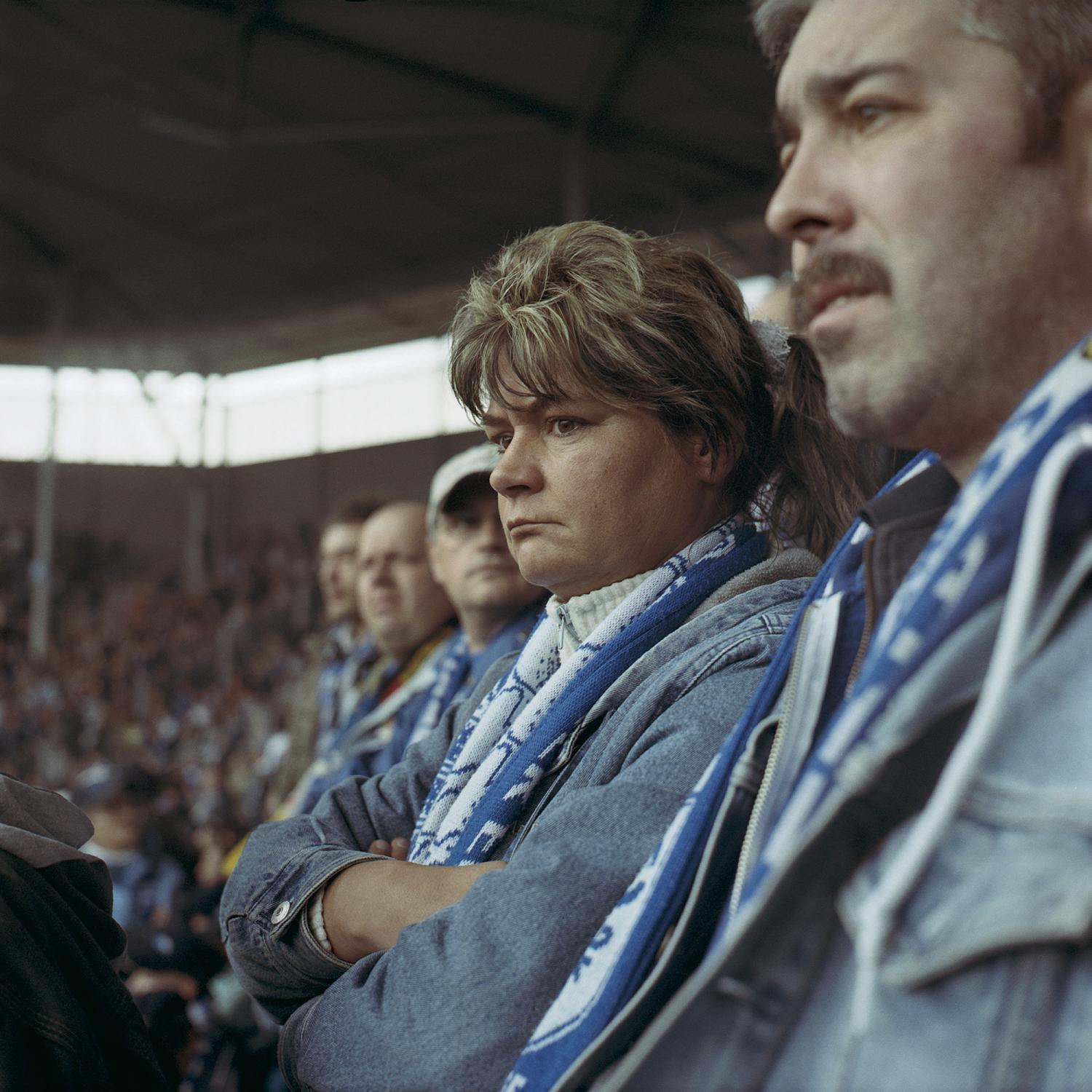 Supporters focus on the game from the terraces of the new stadium in Magdeburg. The stadium was named under the most successful and beloved trainer of the team in the 70's, Heinz Krueger.