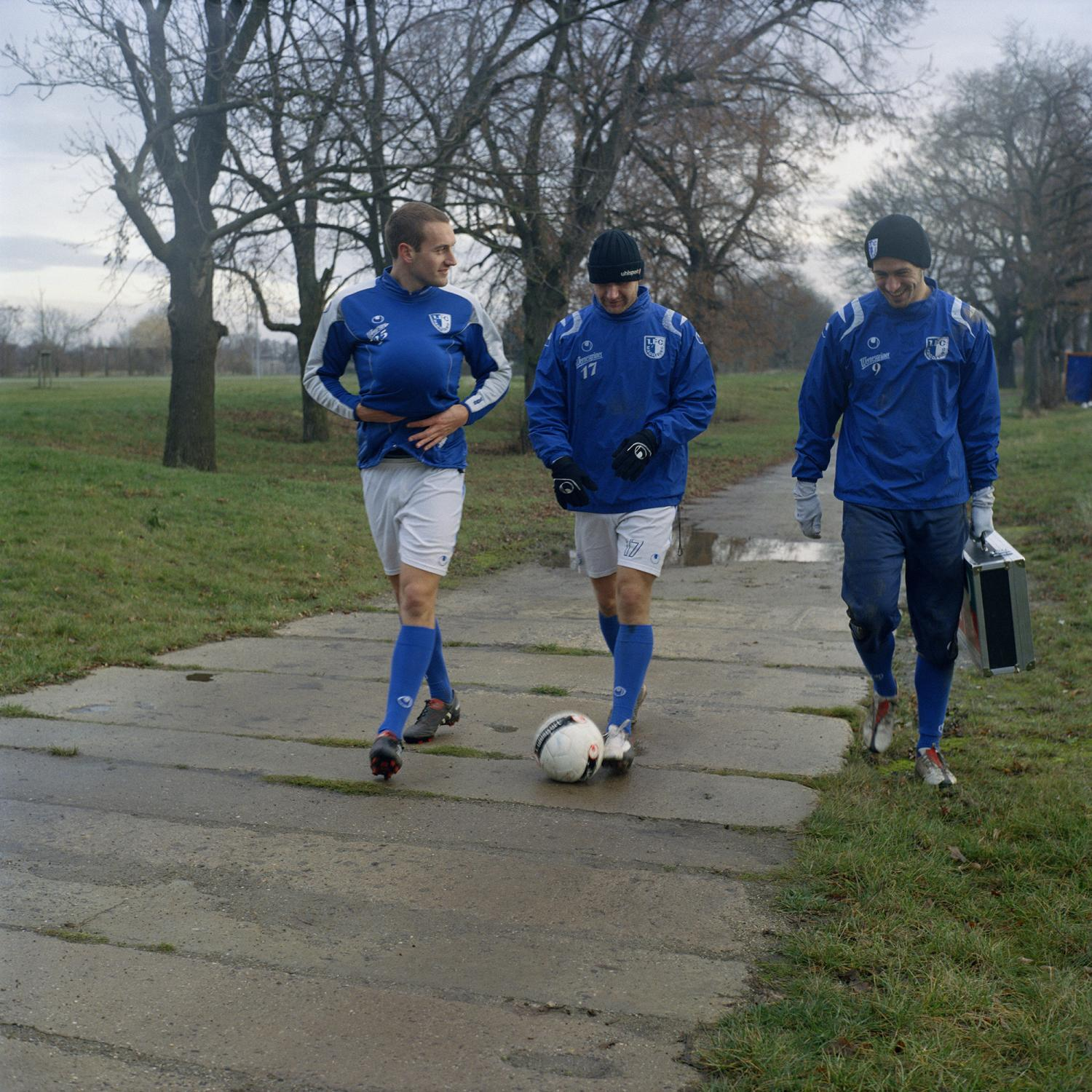 The players Tobias Friebertshäuser (25, L), Marcel Probst (17, C) and Marko Verkic (9, R) walk to the changing room after a training of the 1. FC Magdeburg team, in Magdeburg.