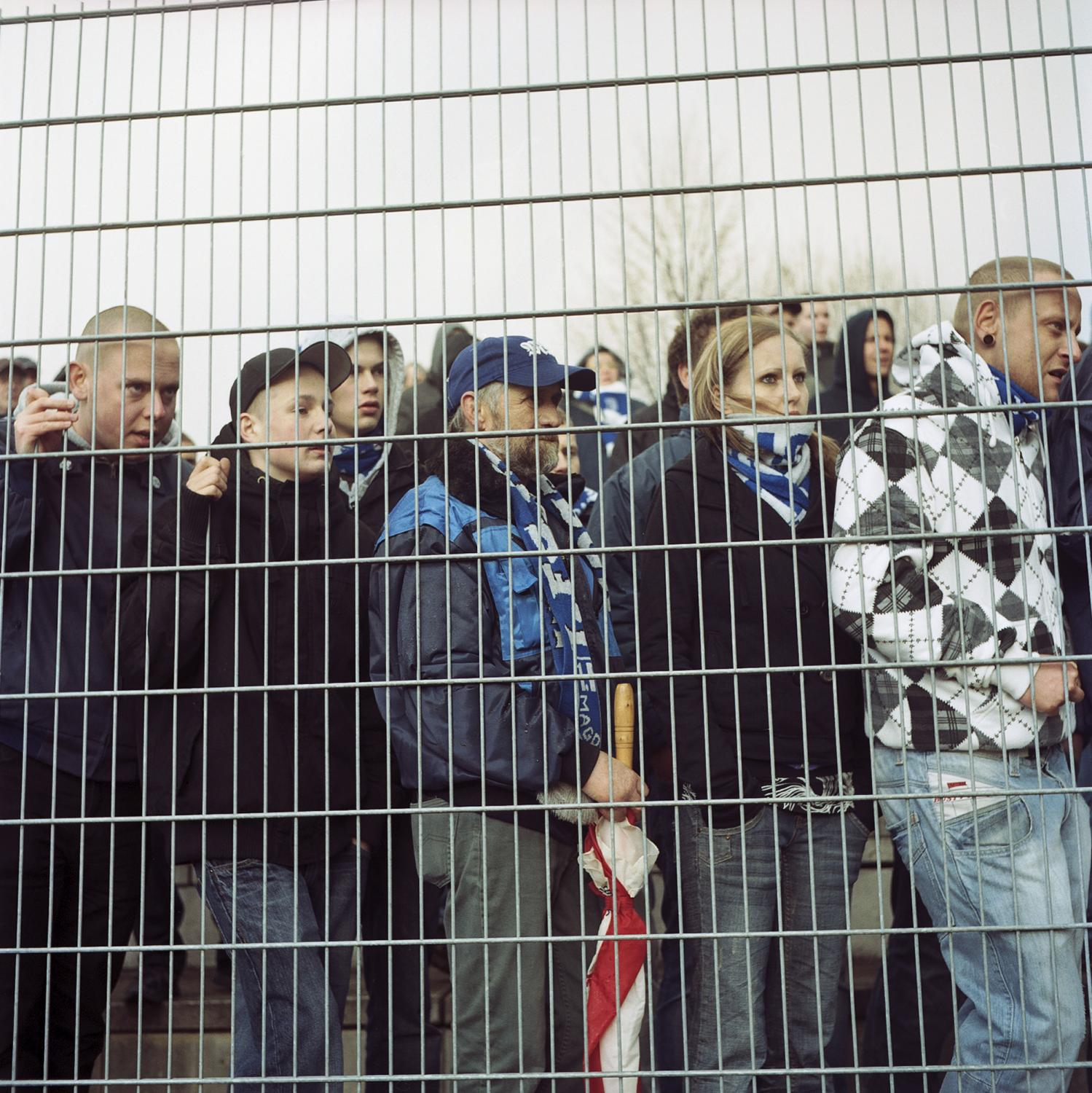 Supporters are seen with sad faces behind a gate in Halberstadt, after the 1. FC Magdeburg did not get through the semi-final against the fifth league club FC Halberstadt. This crushed the hope of winning the Regional Cup, after the the aim of getting ahead in the fourth league was already deceived, leaving the supporters deeply deceived by the performance of the team in the 2009/2010 season.