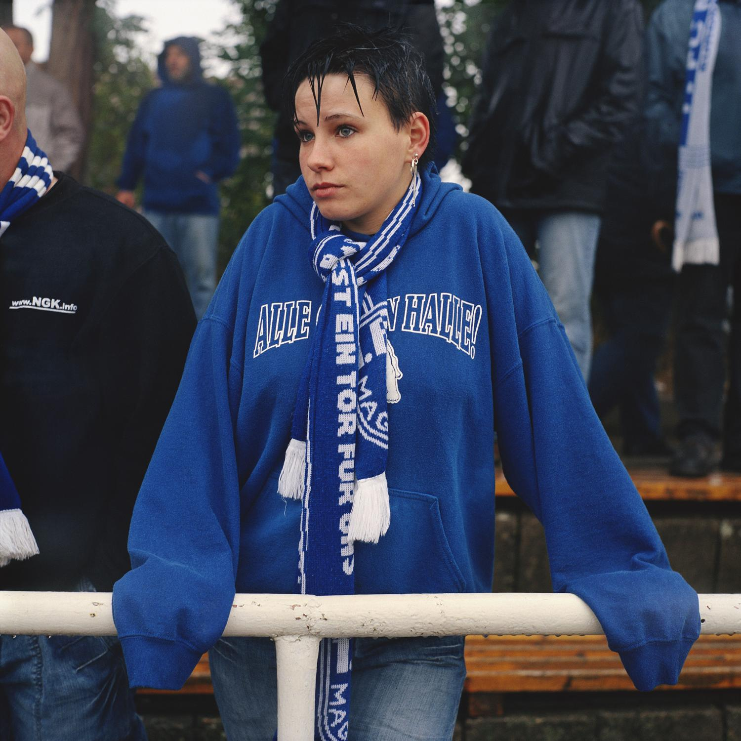 A supporters stands on the stands under the rain in Klötze, during a play of the regional cup VfB Klötze v 1. FC Magdeburg (0:11).