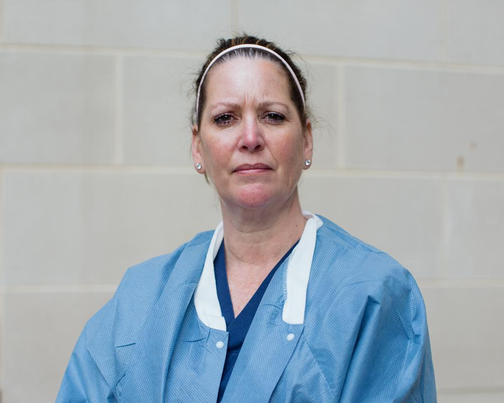 "Tracey Wilson, 53, a nurse practitioner who is caring for COVID-19 patients in an intensive care unit (ICU), poses for a photograph after a 12-hour shift, outside the hospital where she works, during the coronavirus disease (COVID-19) outbreak, Maryland, U.S., April 3, 2020. ""I had a patient fall out of bed today and I had to call his wife and tell her and she couldn't come see him, even though she pleaded and begged to come see him,"" Wilson said. ""There is a lot of unknowns and with that unknown is a lot of anxiety and stress that we're not used to dealing with."" REUTERS/Rosem Morton"