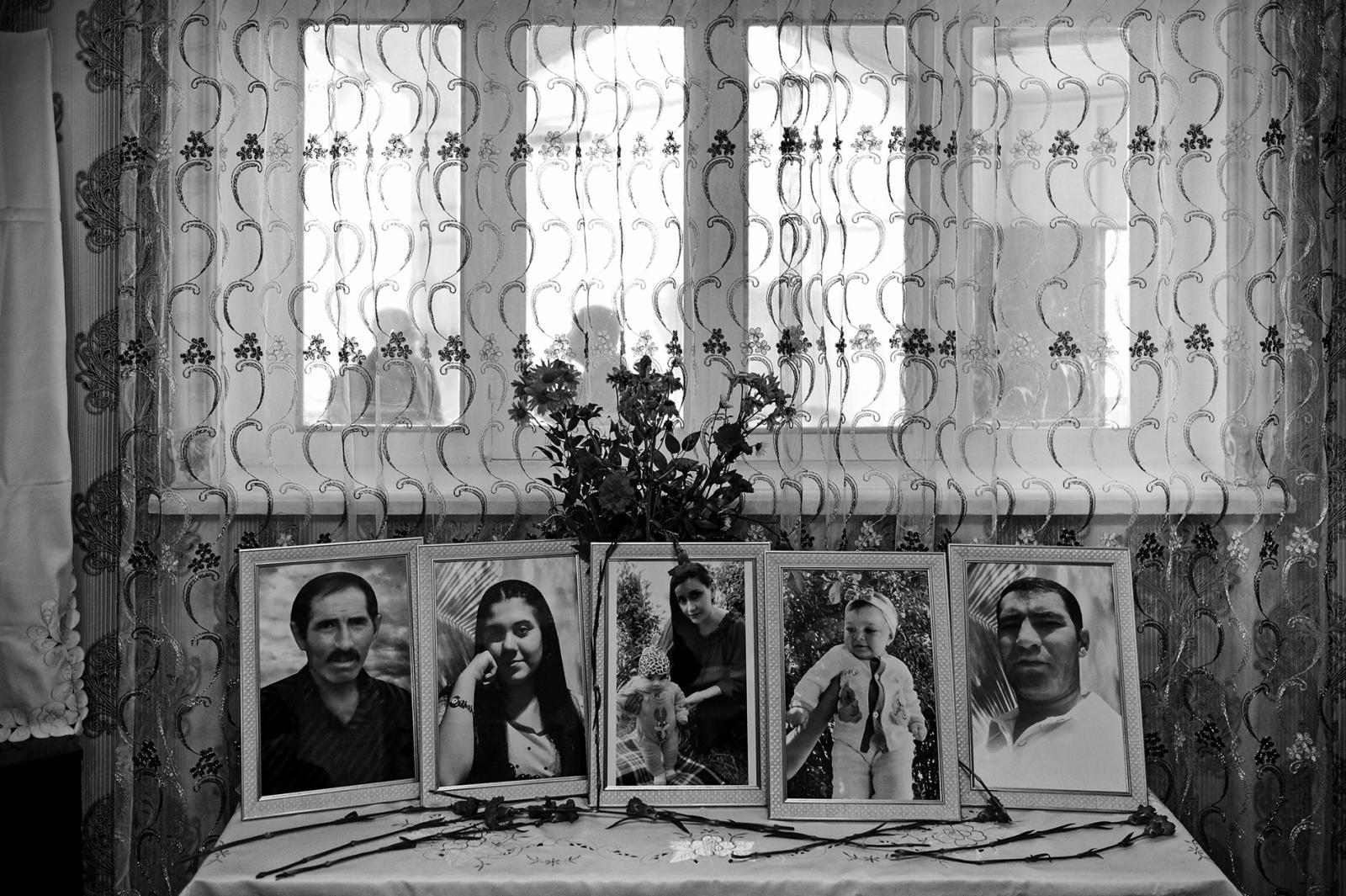 GANJA, AZERBAIJAN, OCTOBER 17 -13 Azerbaijani citizen lost their lives in the missile attack carried out by the Armenian army on the city of Ganja, 60 kilometers from the front line. A family photo were placed on a table in the condolence house. Their dead bodies were removed from the wreckage of their house where an Armenian army missile fell. (from left to right: ather Suluddin Eskerov, grandson Nigar Eskerova, daughter-in-law Sevil Eskerova, 10-month-old grandson Narin Eskerova, son Bahtiyar Eskerov)