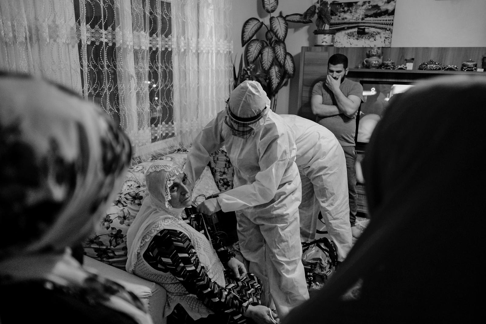 ISTANBUL, TURKEY, MAY 11- An elderly woman seeking help from 112 healthcare teams with suspicion of coronavirus is being treated at her home in Esenyurt, Istanbul. The relatives of the patient follow the healthcare professionals' work anxiously.