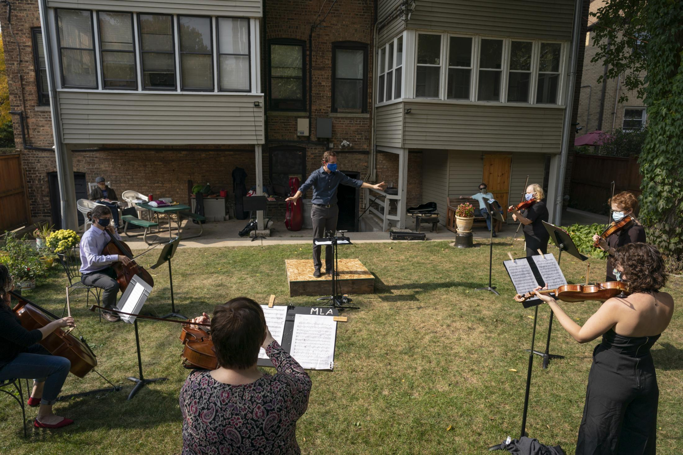 Chicago City Wide Orchestra holds its outdoor recording session in concertmaster Martha Ash's backyard in Evanston on Sunday, Oct. 11, 2020.