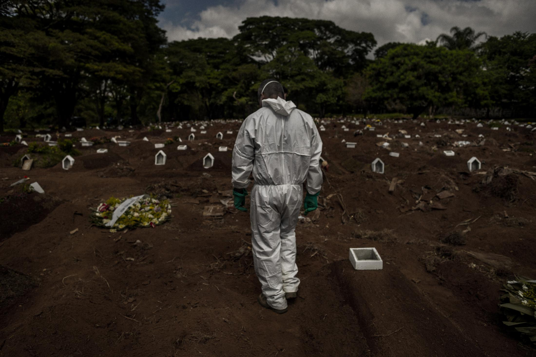 May 15, 2020. A gravedigger rests during the constant flow of burials in São Paulo during the coronavirus crisis in April 2020. Aerial images of Vila Formosa, the largest cemetery in Latin America, were seen around the world at the beginning of the new coronavirus pandemic in Brazil, showing hundreds of open-air graves. The public focused on the victims of Covid-19, but little attention was paid to the silent army of gravediggers, last foot soldiers in a lost war that killed more than 200,000 people in the country by January 2020, according to the Brazilian Ministry of Health. Responsible for burying up to 80 people a day during the crisis, the Vila Formosa Gravediggers have the lowest salary in the city of São Paulo, earning less than $250 a month in a job that risks their lives and their mental health. Alcoholism and depression are part and parcel of their work. Names in this report have been changed to protect identities.
