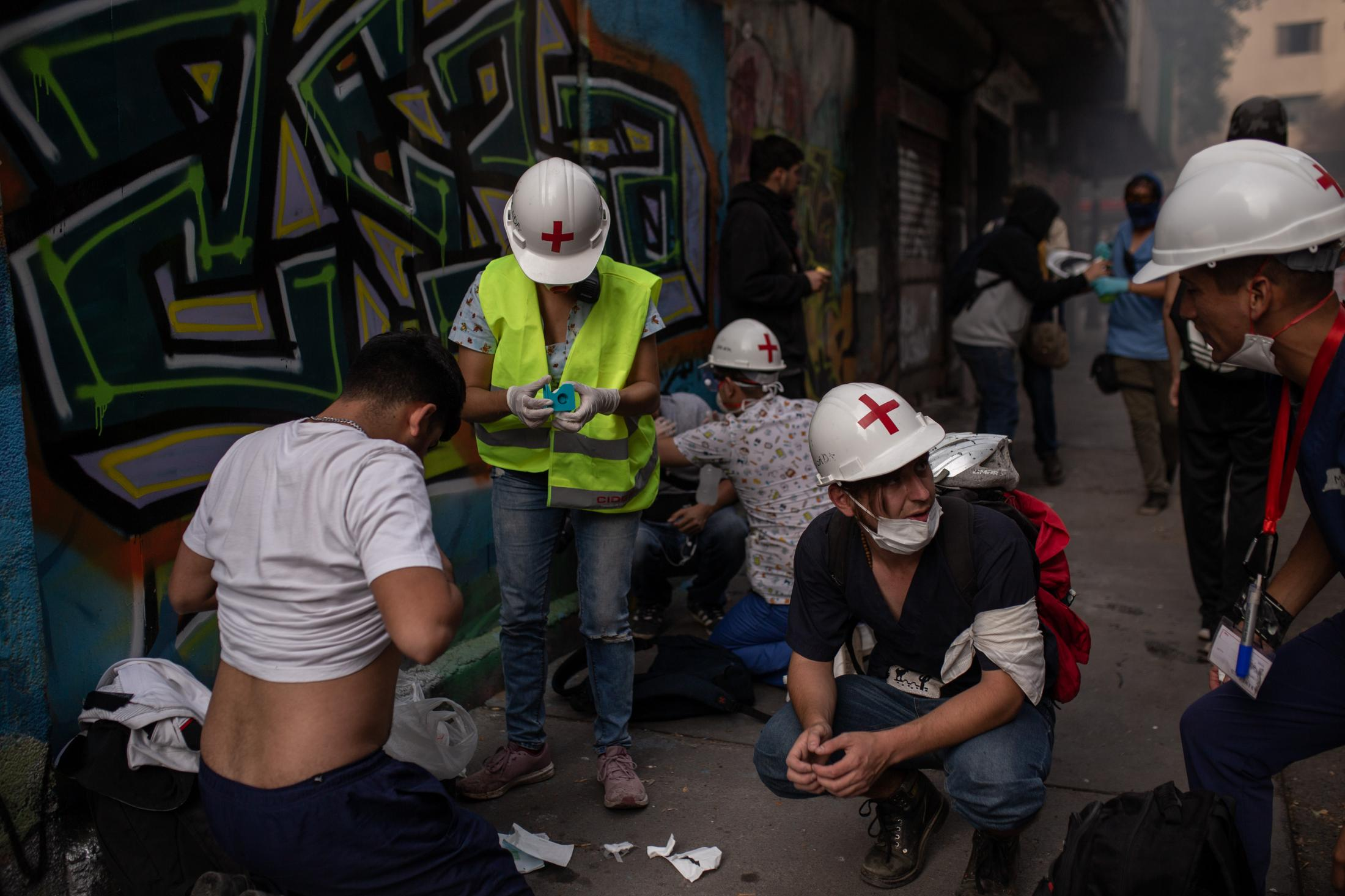 November, 4, 2019. A group of volunteer nurses attend to injured people during a day of protests in Santiago, Chile