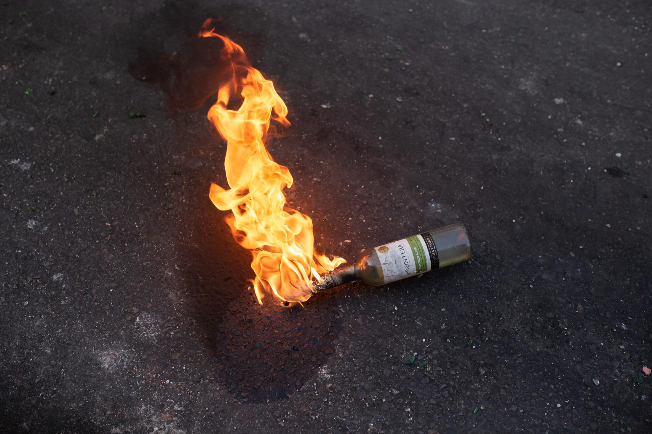 January 19, 2020. A Molotov cocktail burns on the ground after being thrown by protesters during a day of protest in Valparaíso, within the context of the social outbreak.