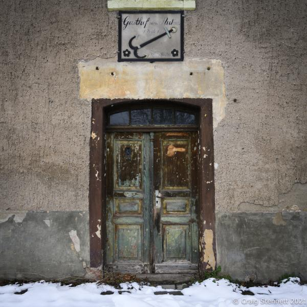 Abandoned Guets house, The dating stone says 1841 with the original proprietor being an Otto Richter. The building has been empty for many years and is now starting to collapse. Salzatal, Saxony-Anhalt, Germany.