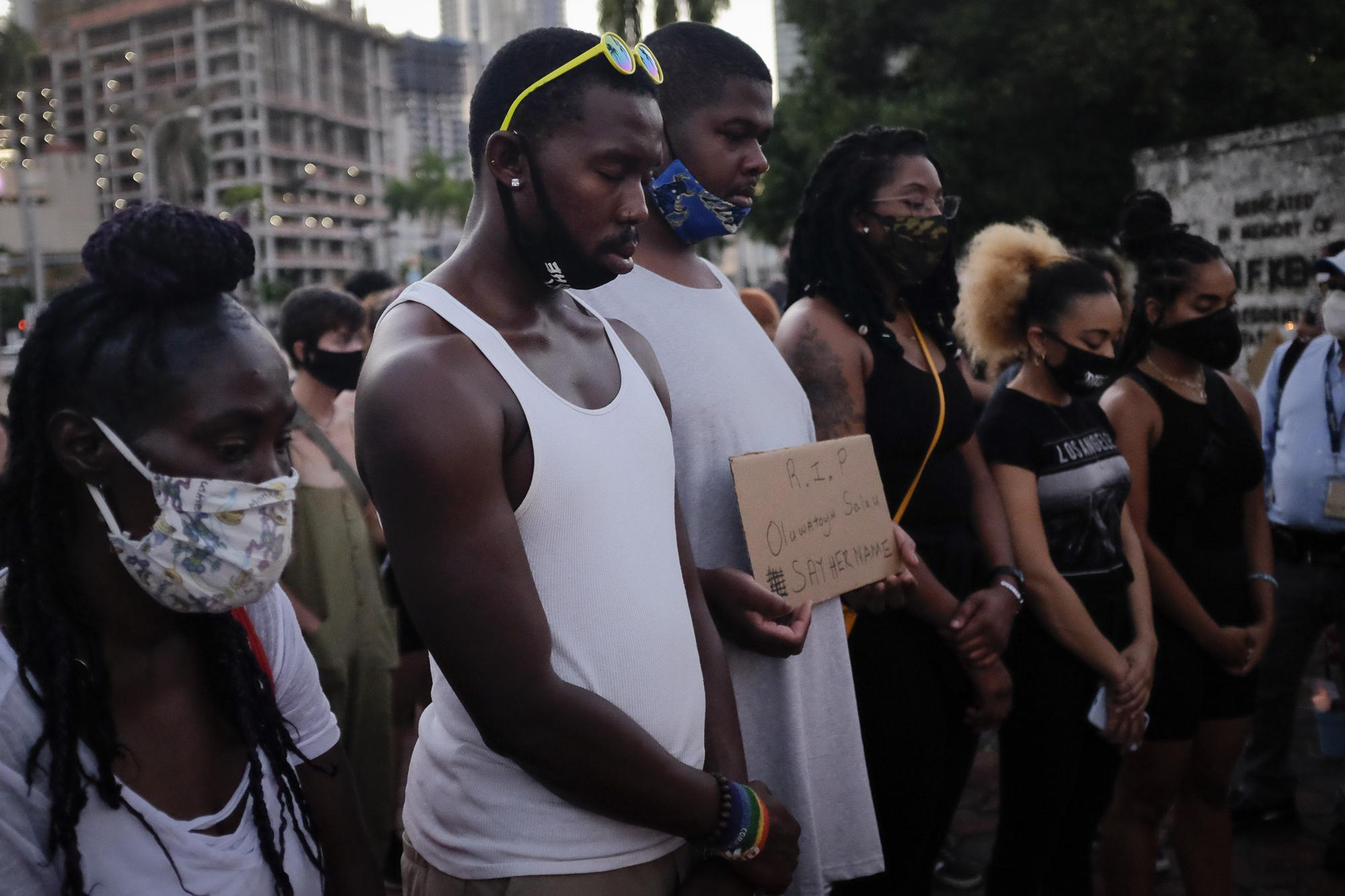 People attend a vigil for slain black activist Oluwatoyin Salau, in Downtown Miami, Florida, U.S., June 16, 2020. REUTERS/Marco Bello