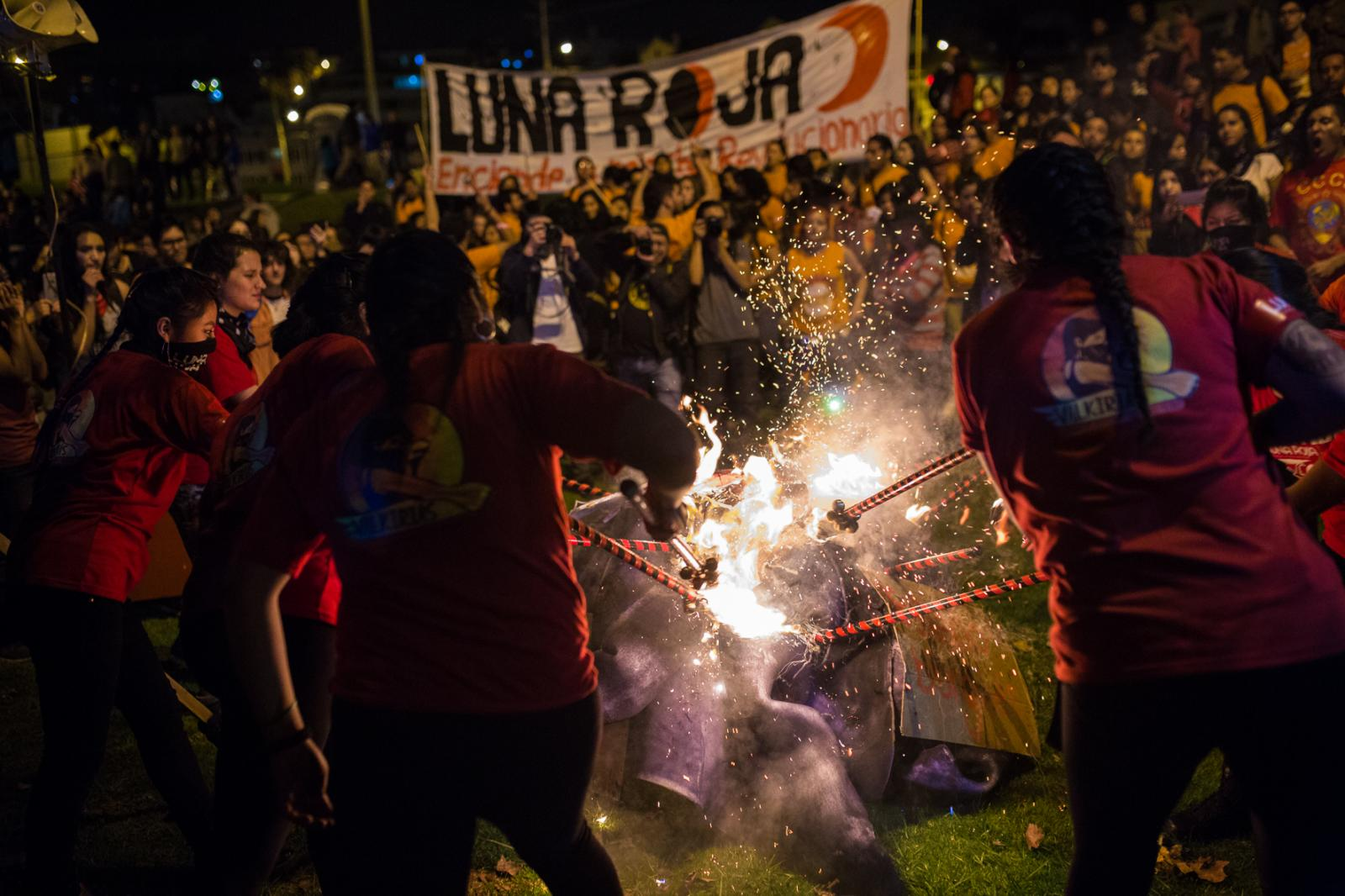 Women from organization Luna Roja burn dolls on the night of June 25, 2017 in El Arbolito Park, representing the state in claiming for the cases of femicides that have gone unpunished. Quito, Ecuador.