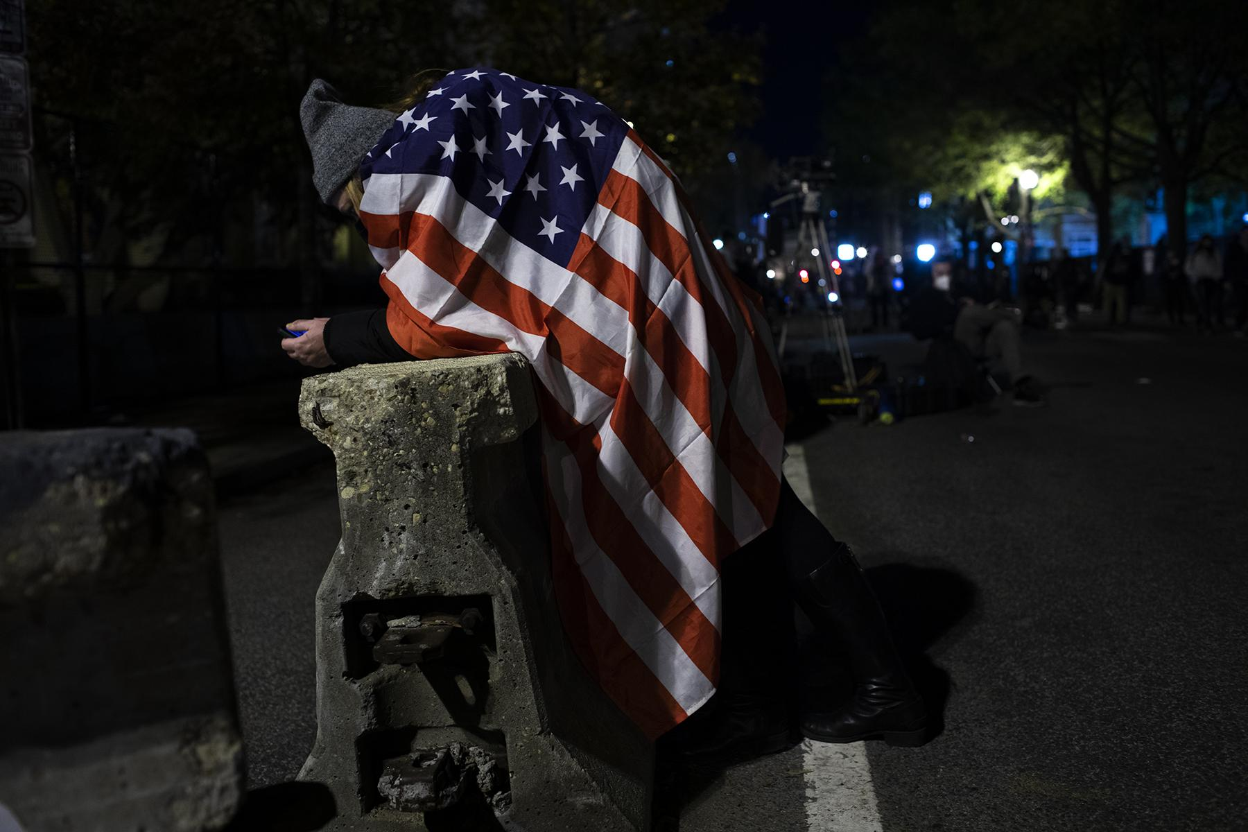 Raelyn Maxwell takes a break from protesting at BLM Plaza in Washington D.C. on November 3, 2020, Election Day.