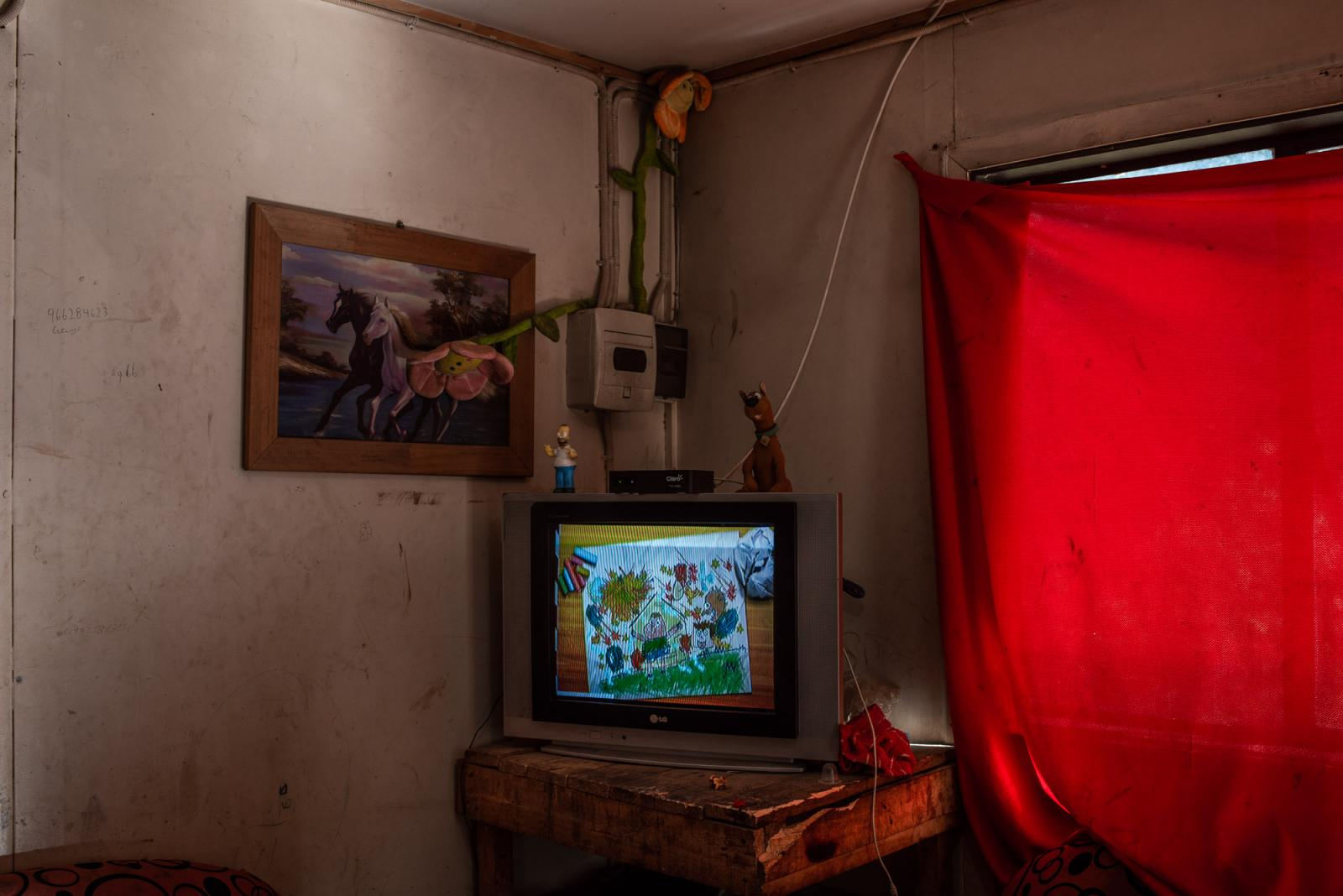The living room of the Torres-Toro family. One of the sons, S.T (14) was shot in the leg by the police during a raid at this home in Pidima area, Araucanía, Since April 20, 2017 Silvestre lives with five bullets in his left leg, one of which is partially embedded in the kneecap and another dangerously close to the femoral artery. Araucanía region, Chile. April 7th, 2019.