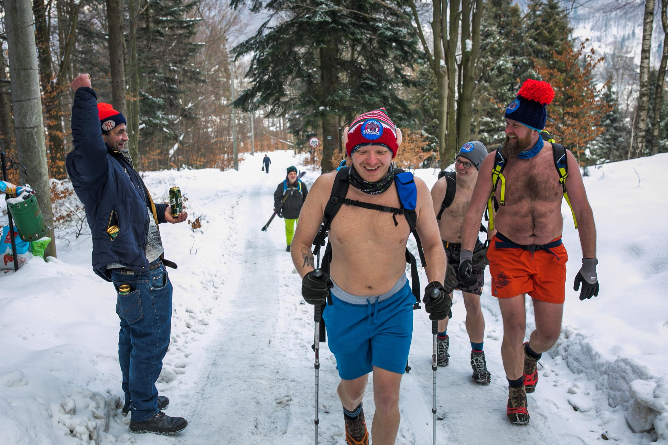 31.01.2021 Szczyrk, Poland. A group of friends climb to the top of Skrzyczne Mountain without warm clothes.
