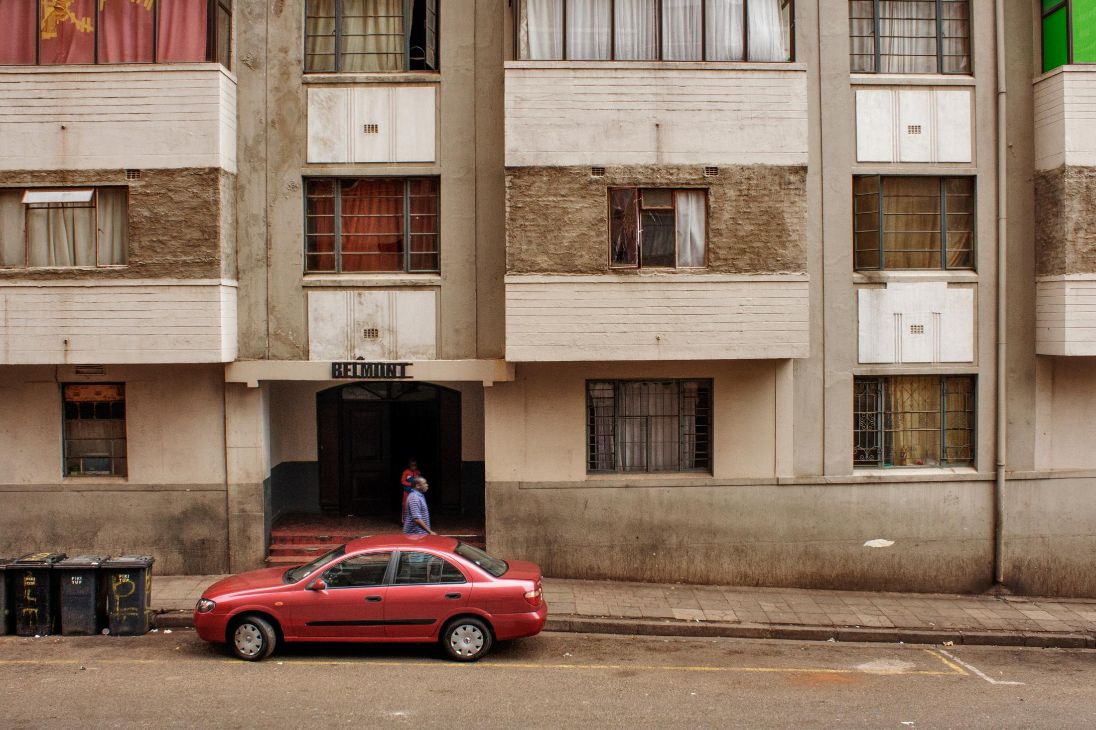 "A building with a bricks fault lines on corner Bankent and Varndermerwe street in Hillbrow in Johannesburg, Soputh Africa, Sept 06, 2016. This building was once known as Bell Mount Hotel now the balcony has bee reconstructed on top of a old structure as neighbourhood undergoing through transition and need of cheap accommodation. Hillbrow is an inner city residential neighbourhood of Johannesburg known for its high level of populationdensity, unemployment, poverty, prostitution and crime. This project ""Transition"" looks at the short and long-term changes that have occured and continue to occur in the area, and the effect of life here on the people."""
