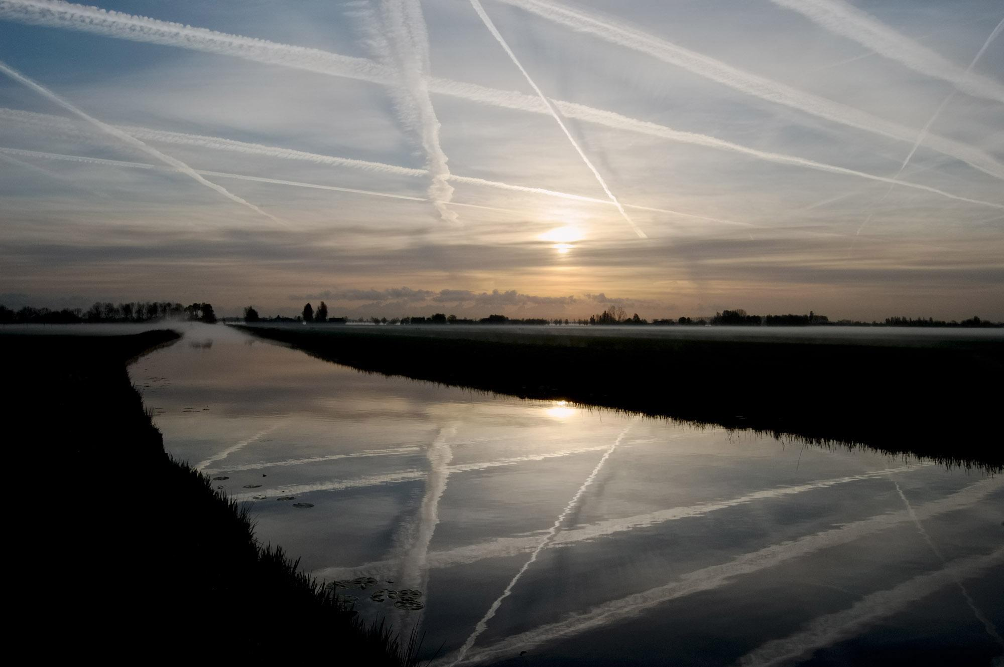 Sunrise above the Cattenbroeker Polder and the Montfoorts Canal. Linschoten, Utrecht, The Netherlands. April 2007.